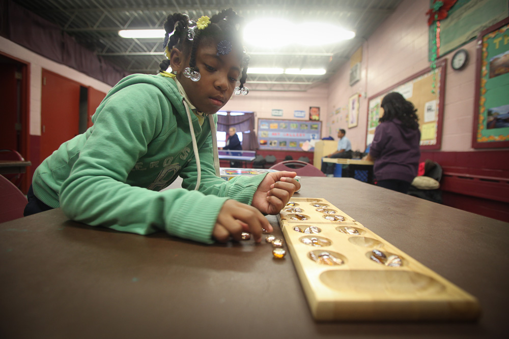 Samiyah Beckham plays a board game at one of Eastern North Philadelphia's few playgrounds.