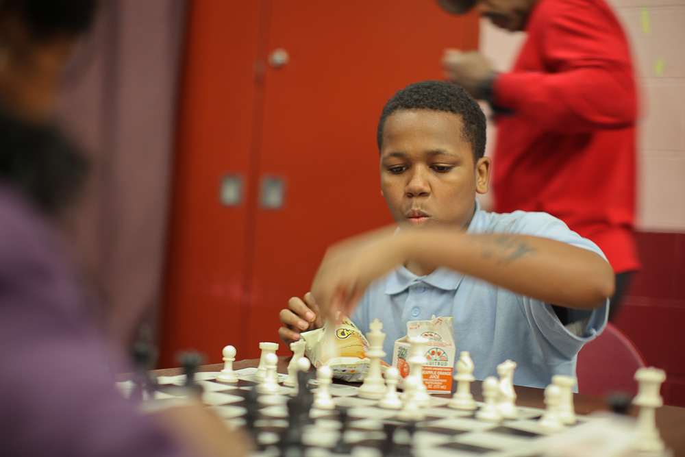 Teddy Kilgore plays chess while at an afters school program at the playground located on 8th and Diamond Streets.