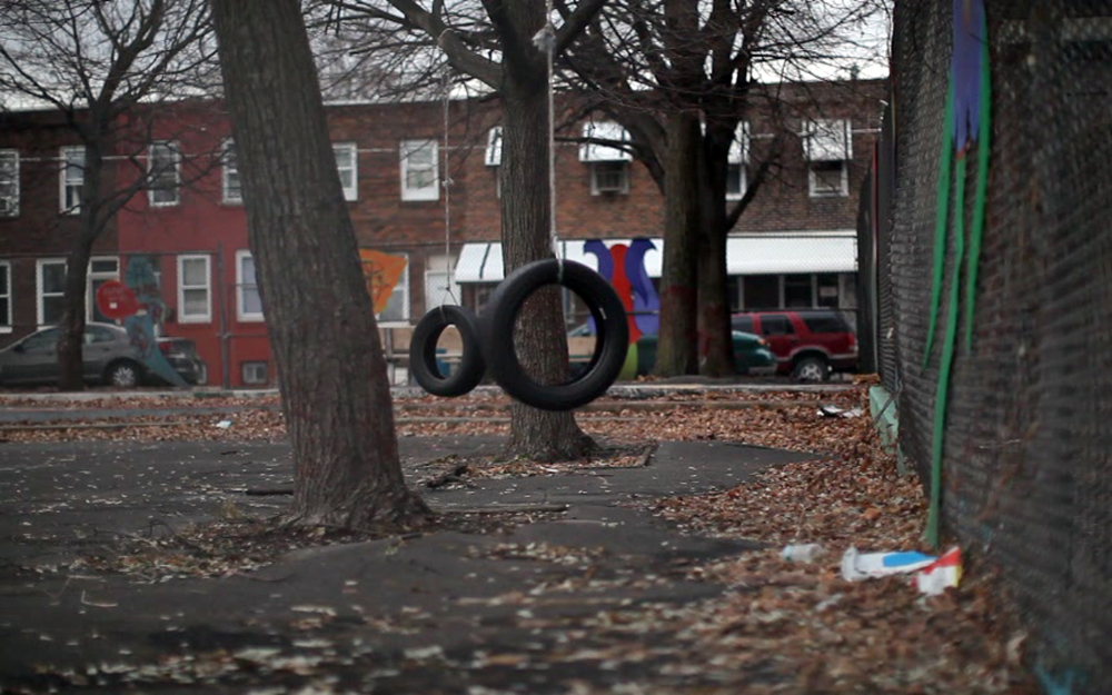 Tire swings hang from trees at a small park on 5th street near York and Dauphin.