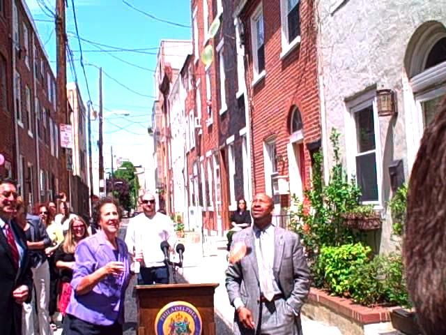 Mayor Nutter and city officials throw water balloons to showcase the porous street.