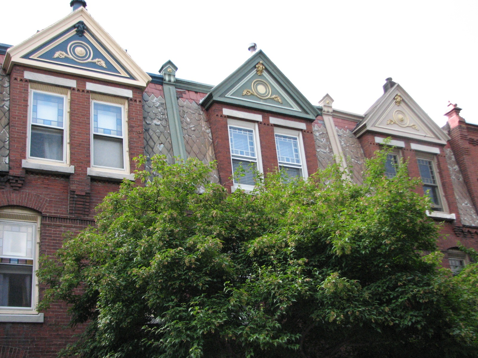 Fancy gables and sloping shingles stand out on the west side of Woodstock Street.