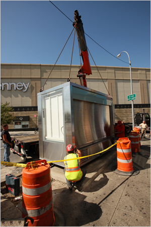 James Estrin/The New York Times / One of the new CEMUSA newsstands was installed last week near the Queens Center mall.