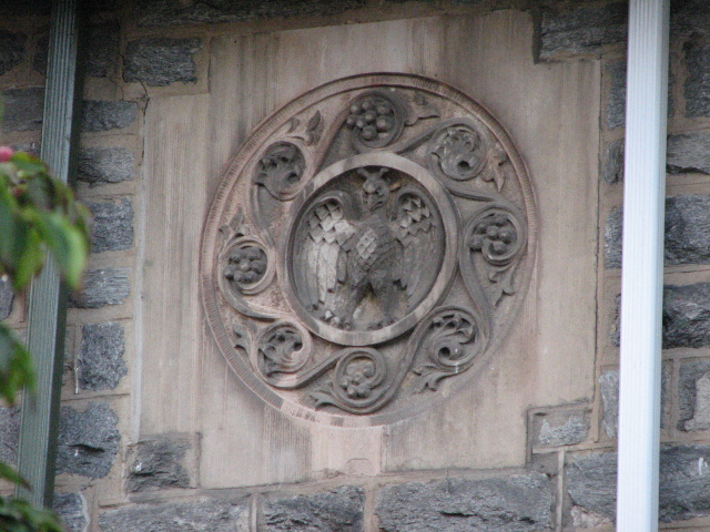 A distinctive medallion shared by the twin homes also appears on several other houses in Overbrook Farms