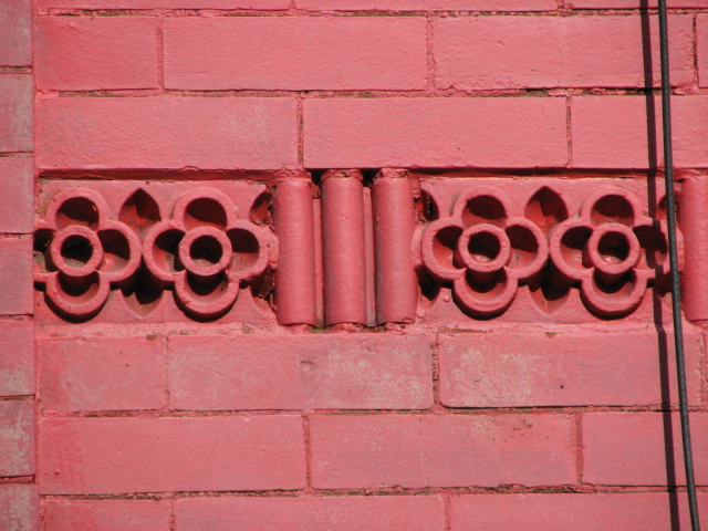 A variety of decorative terra-cotta designs are found on the walls of the Rowan Street houses