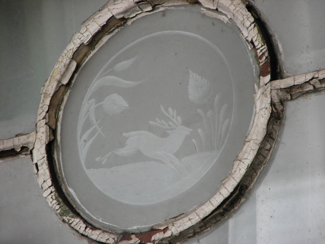 At the center of some windows are etched glass animals.