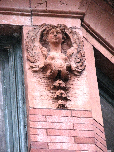 The 19th-century penchant for stone and terra-cotta adornment are found up and down Green Street in the form of angels, cherubs,