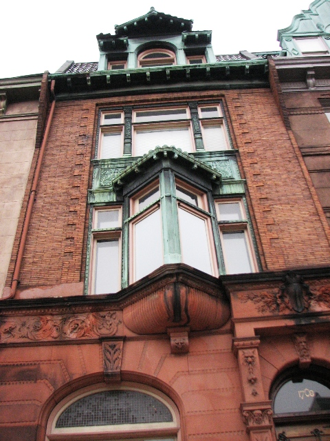A fanciful façade on the 1700 block is attributed to architect Willis Hale.
