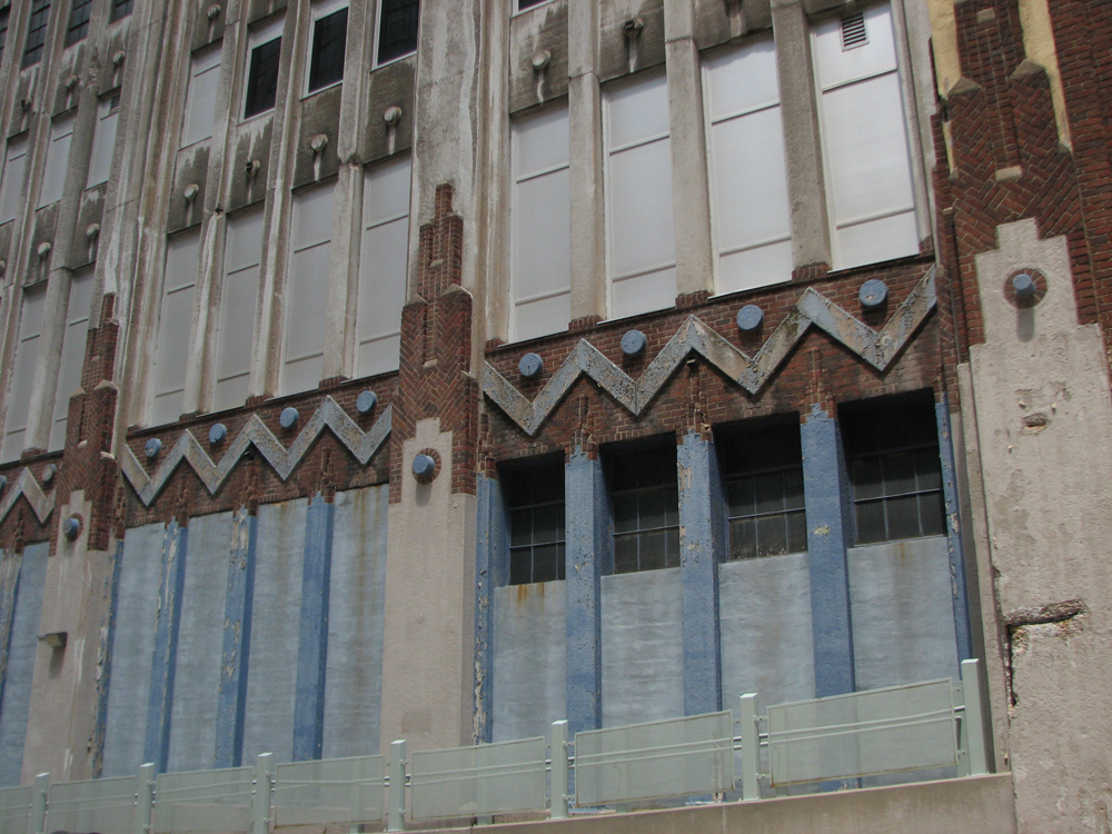 On the Noble Street side, the Lasher building shows off its raised chevrons and circles.
