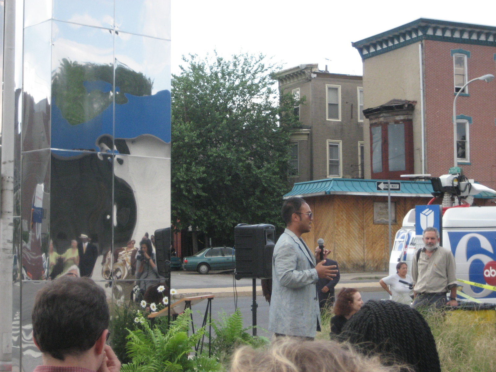 Artist Jeffrey Manuel explains to neighbors in Powelton Village the creative process behind the new sculpture.