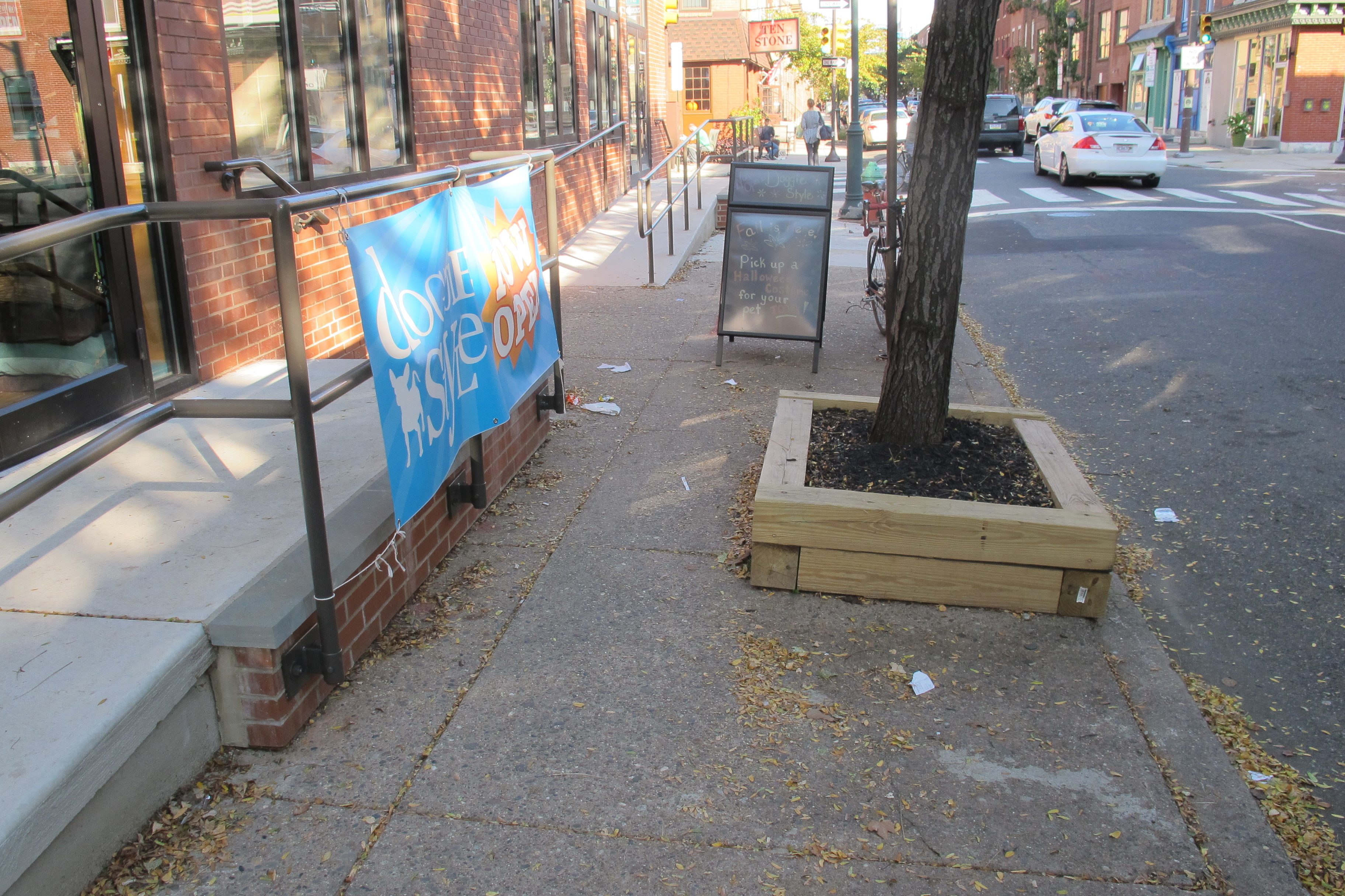 Between the new ramp and the street tree, the sidewalk becomes about 3 feet wide.