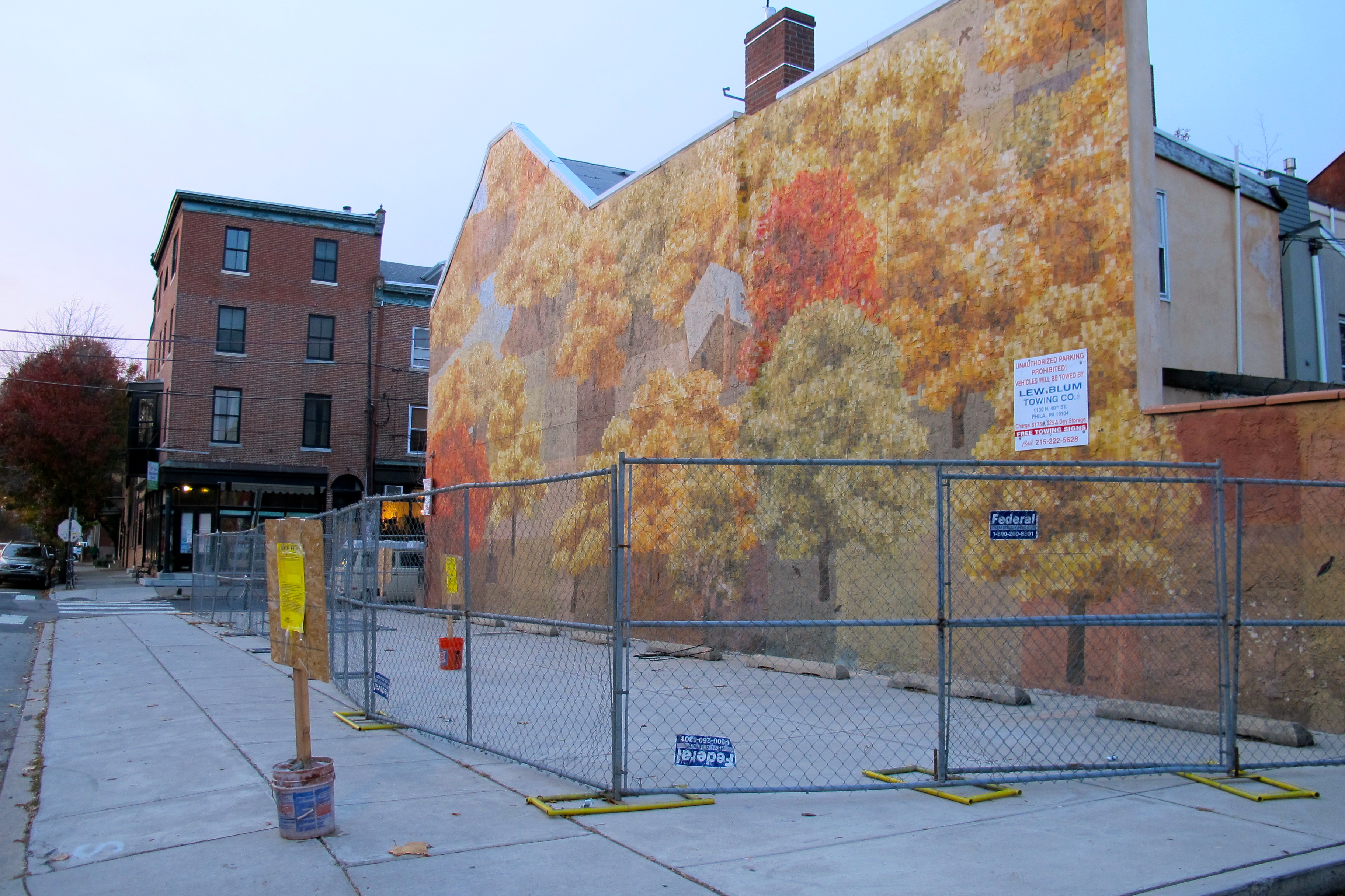 David Guinn's mural at 9th and Bainbridge gets fenced.