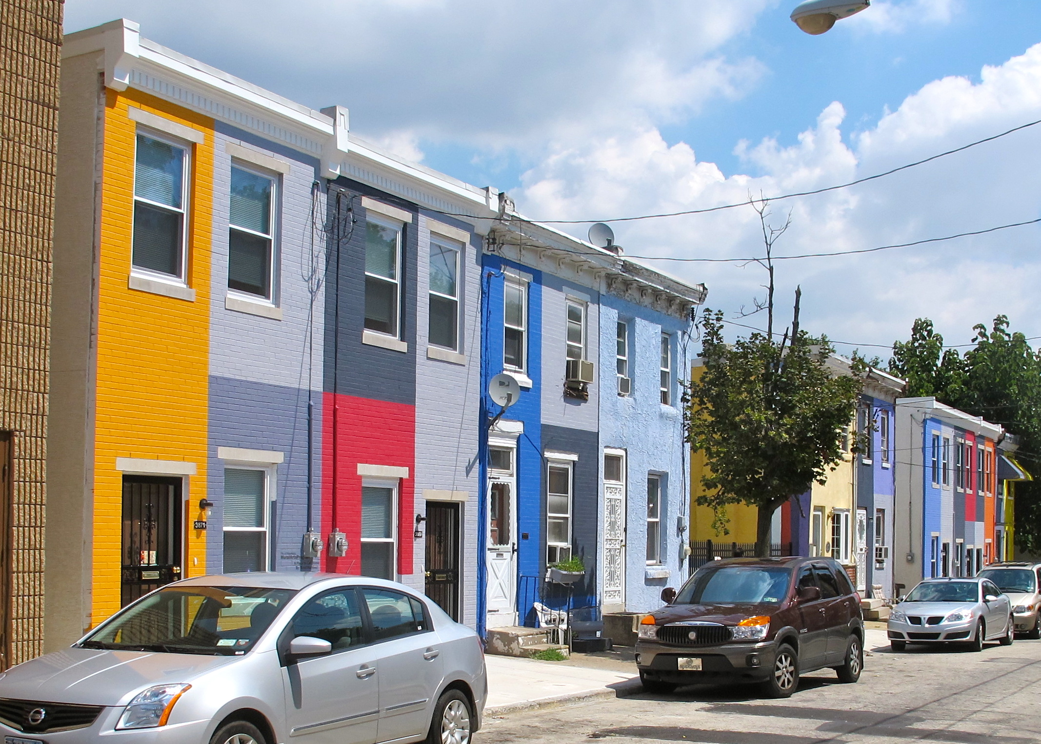 As part of its project A Place to Call Home, the Mural Arts Project painted the facades of the more than 30 homes on the 3800 block of Melon Street.