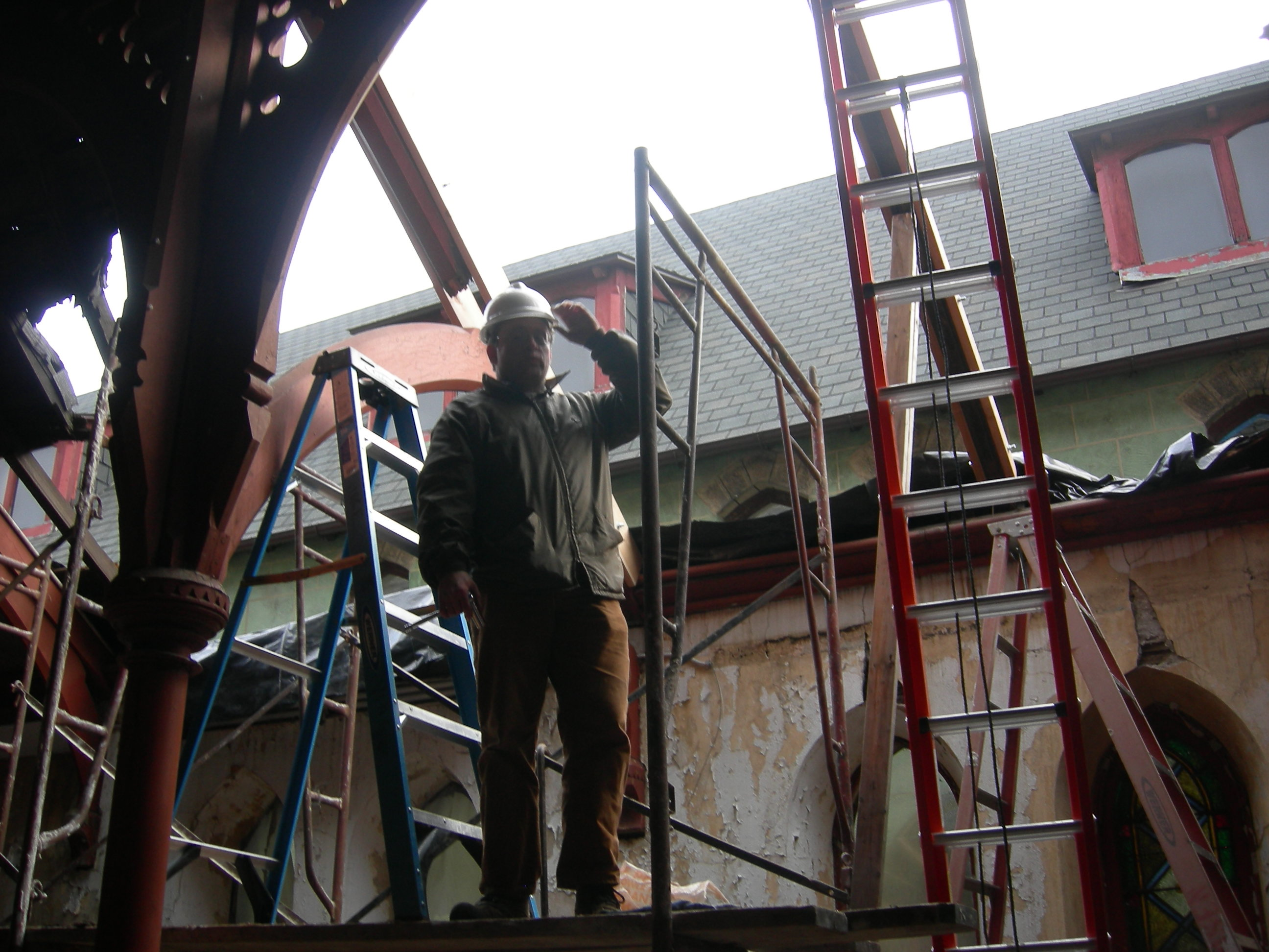 Aaron Wunsch, professor in PennDesign's historic preservation program, on scaffolding during roof repairs. | photo by Melissa Jest, Preservation Alliance for Greater Philadelphia