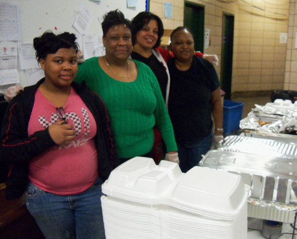 (L-R) Fatima Pickens, 19th district police officer Tina Jeter, Hollie Coleman and Marilyn Garner served chili and rice to the people at the Helping Hands Project. | Connor Showalter