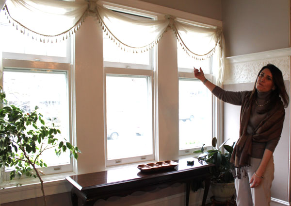 Overbrook Farms Club Board Member Stephanie Kindt presents an original window in her home located on the 6300- block of Overbrook Avenue.