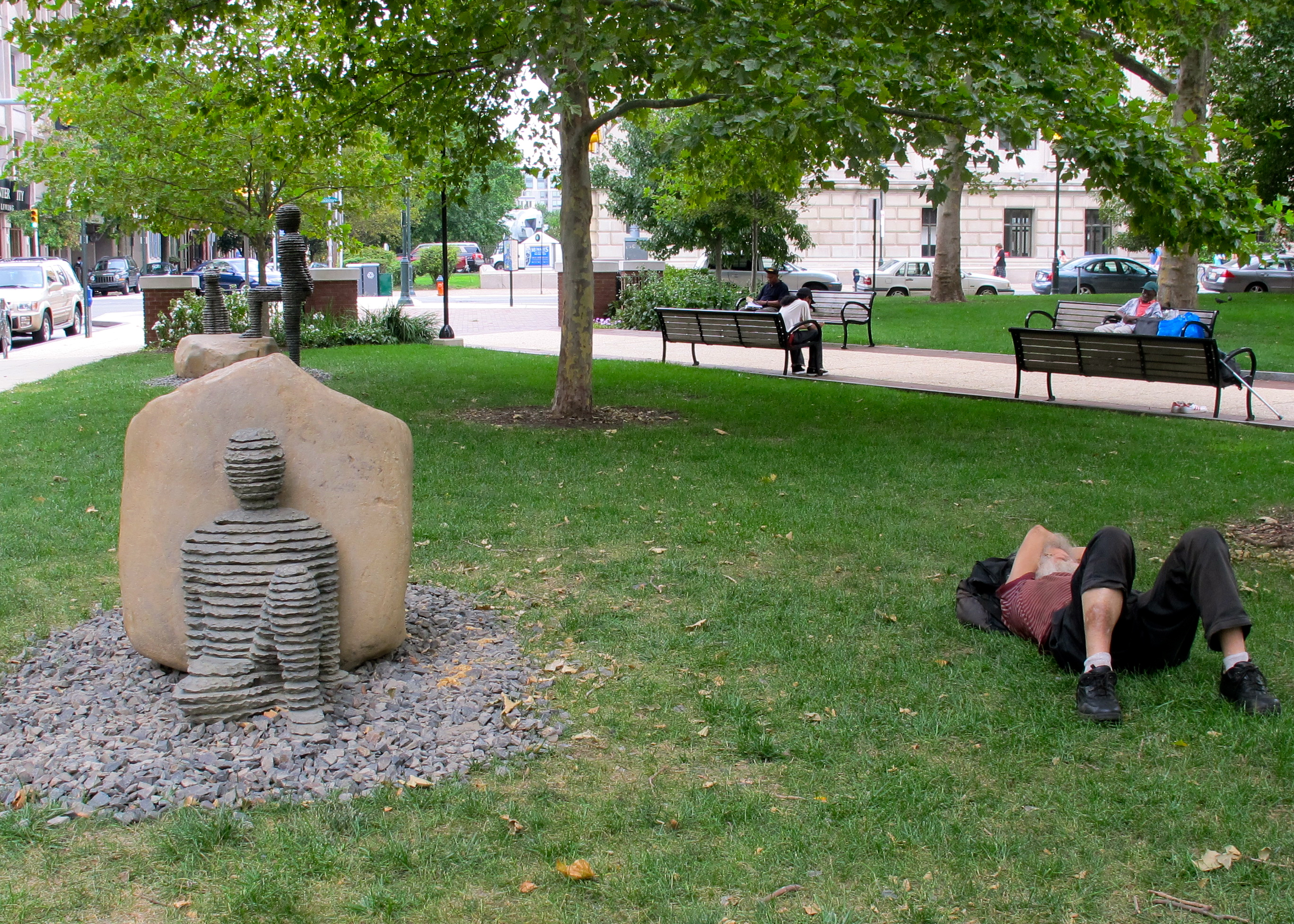 Art imitating life: homeless man sleeps in Aviator Park next to one of the recently installed Boaz Vaadia sculptures.
