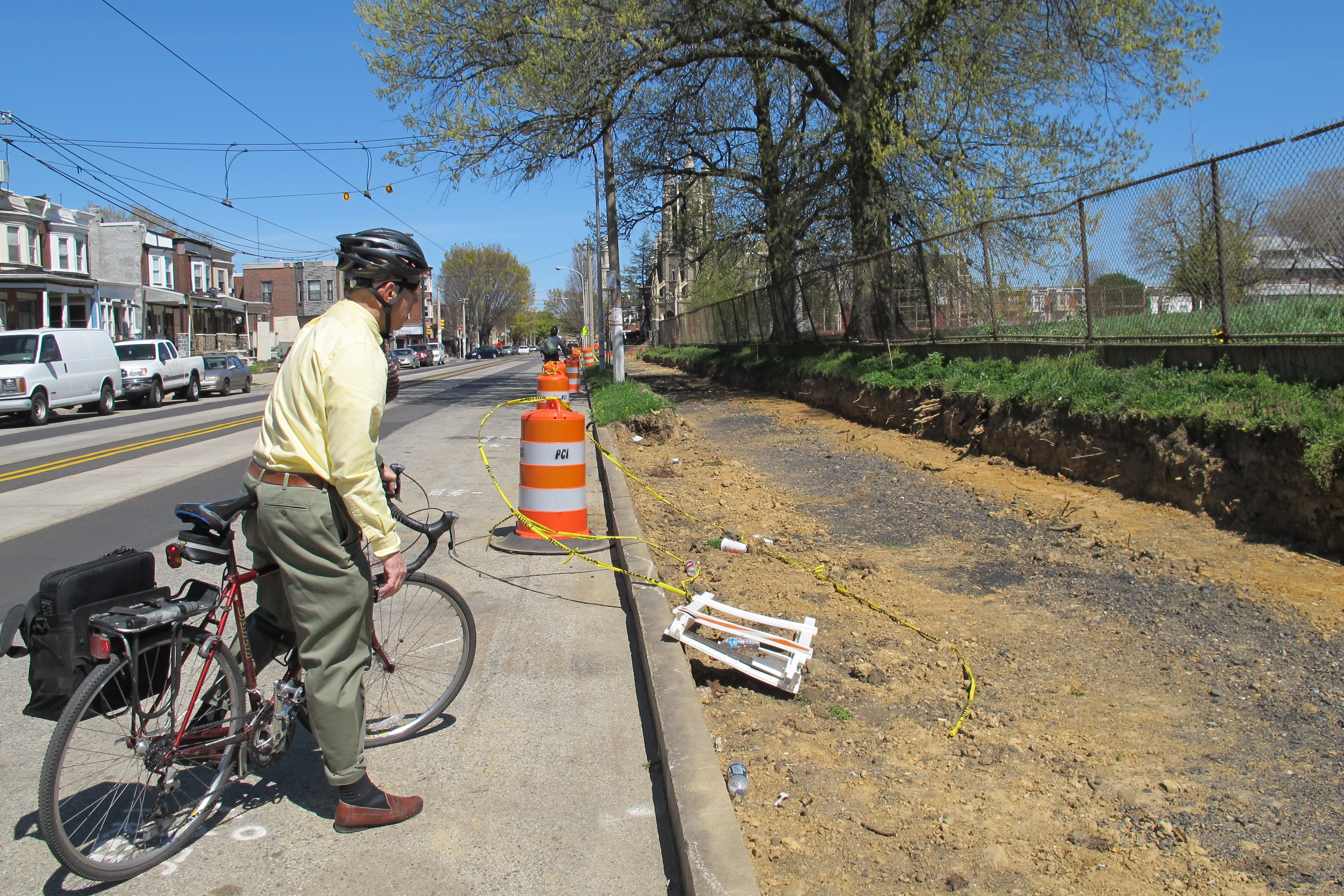 Charles looking at the greenway under construction along Chester Avenue.