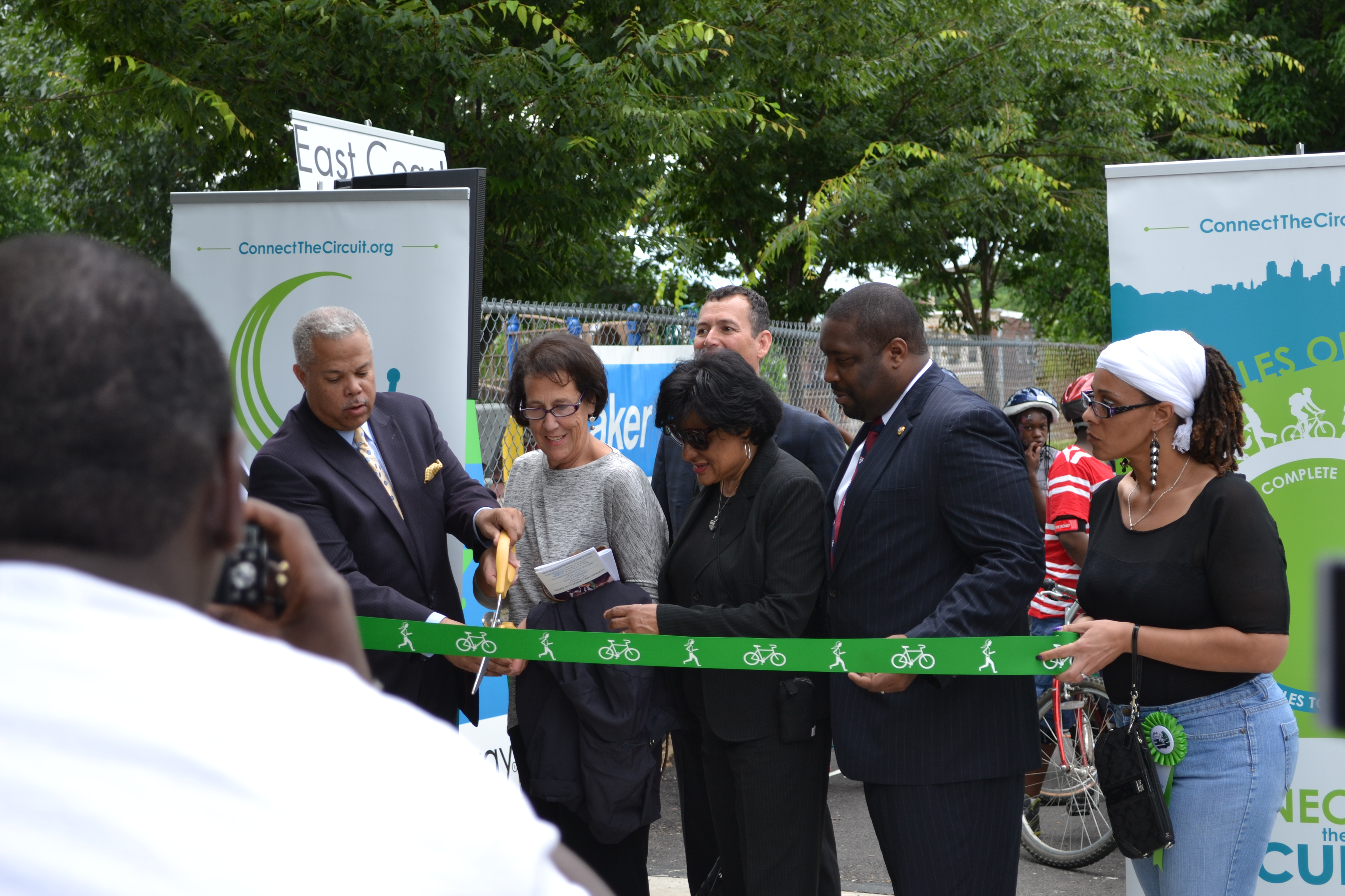 City and state officials along with project leaders cut the 58th Street Greenway ribbon