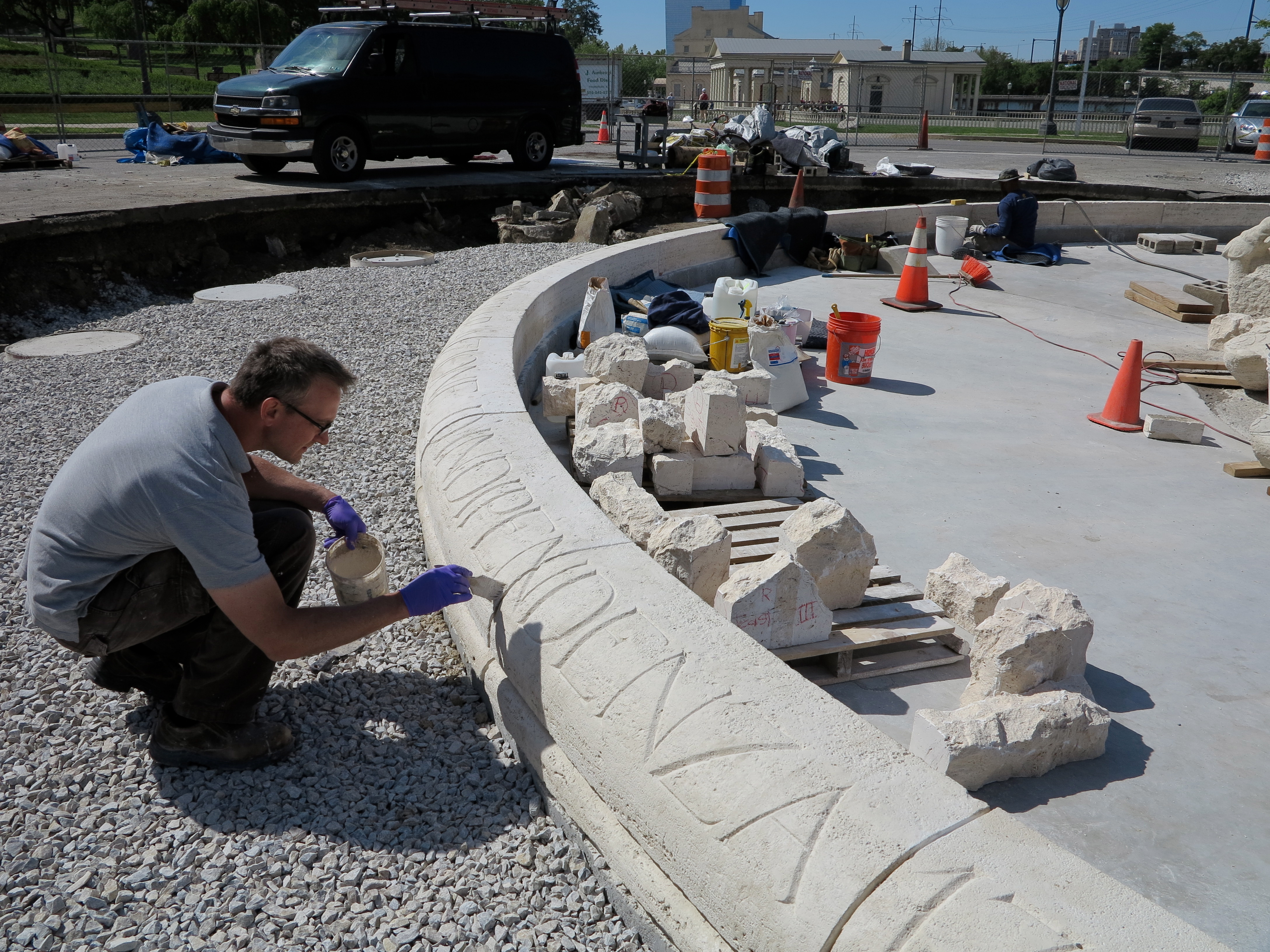 Conservation technician Lee Dunsmore working on the basin's copingstones.