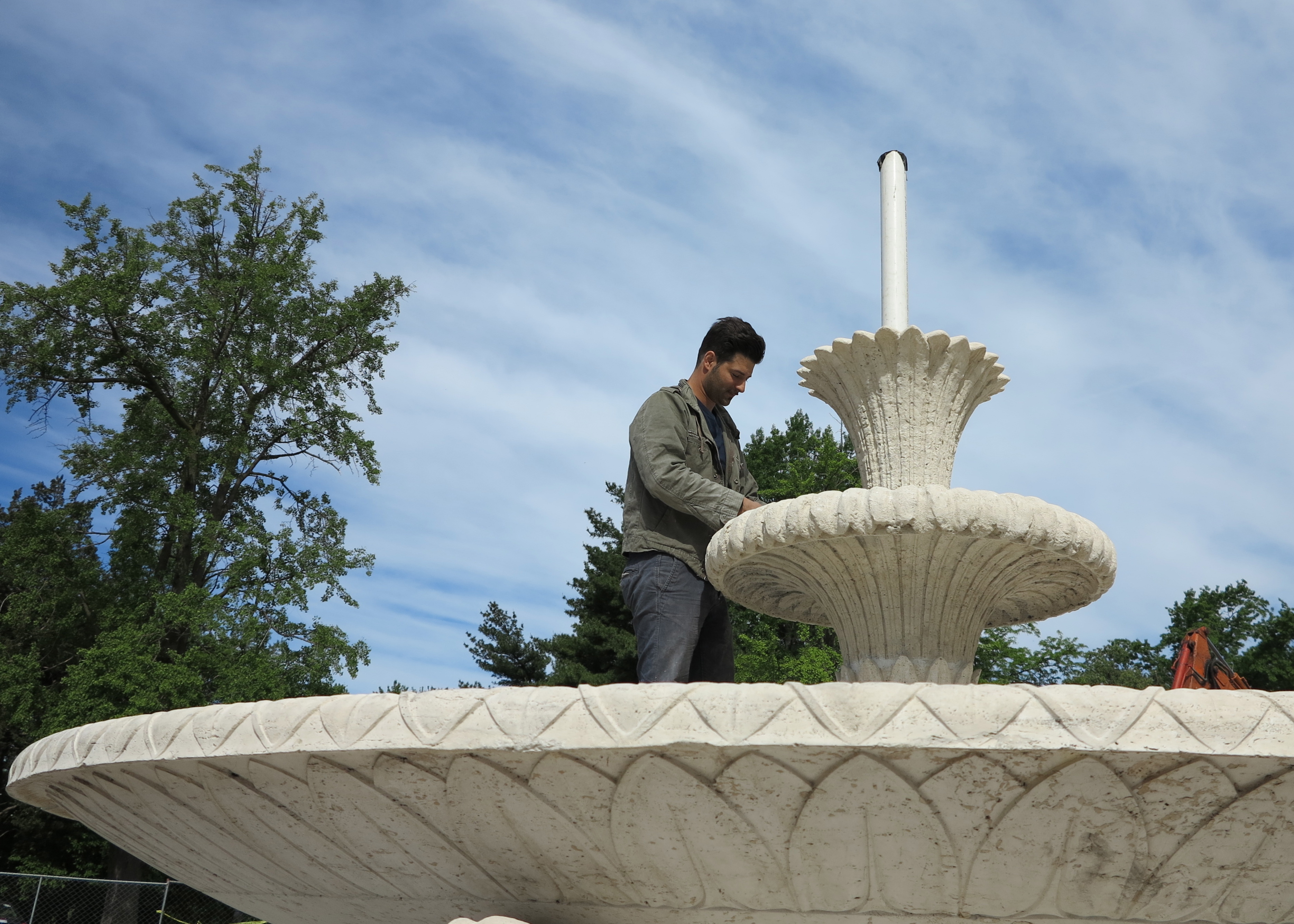 Conservator Marco Federico in fountain's shallow bowl.