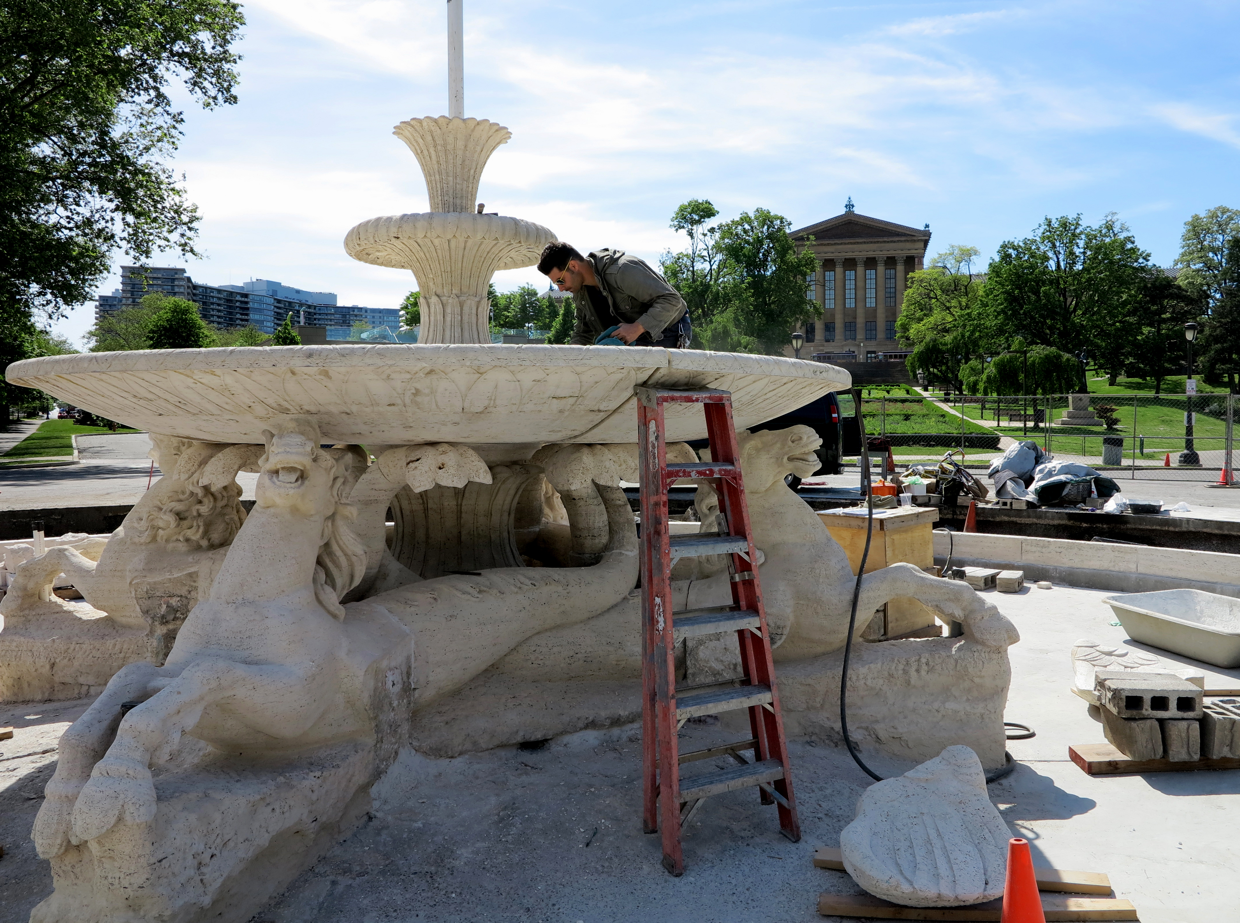 Conservator Marco Federico working in the fountain's shallow bowl.