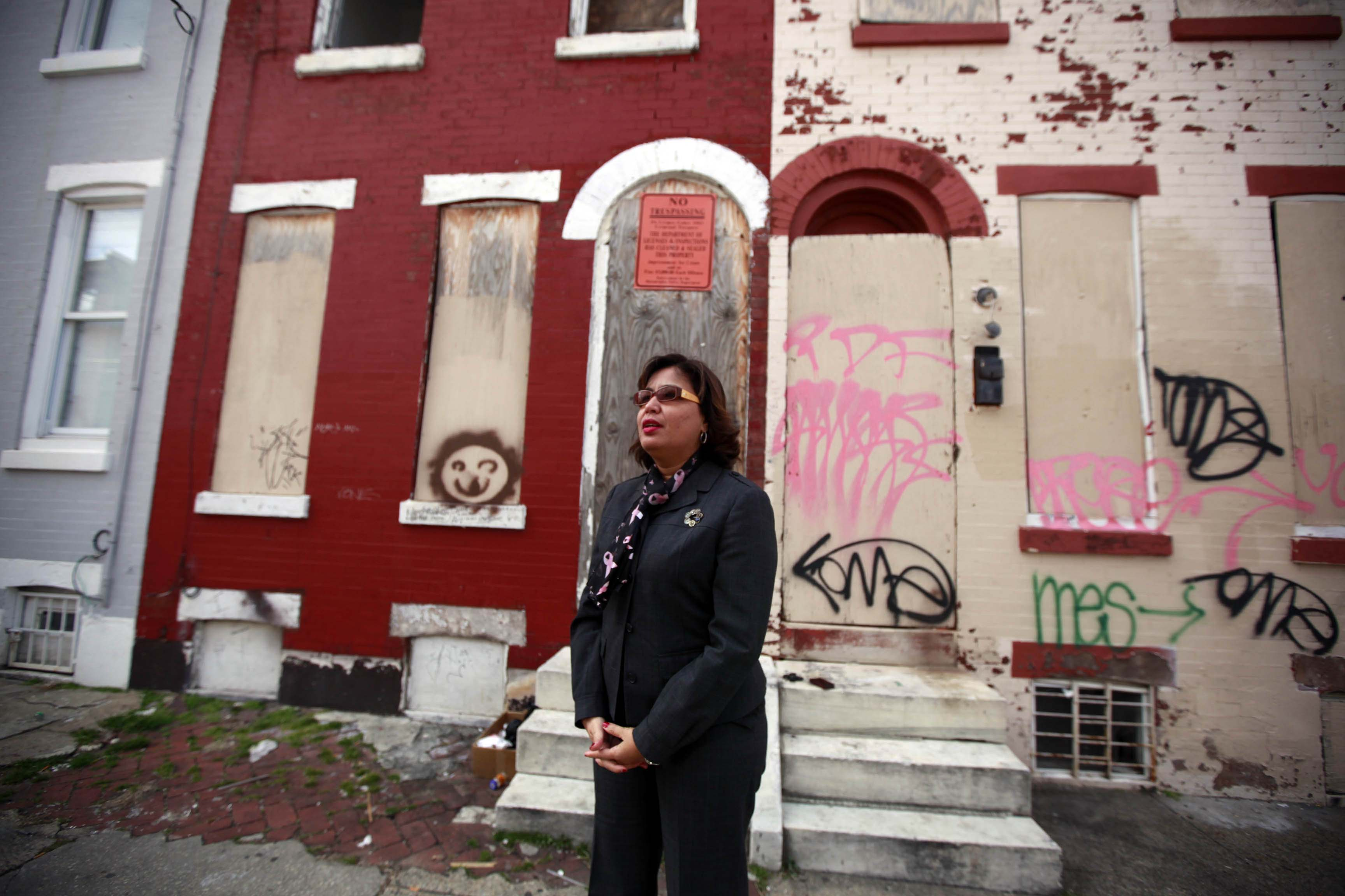 This 2013 photo shows Councilwoman Maria Quiñones-Sánchez stands in front of a blighted home in her district.