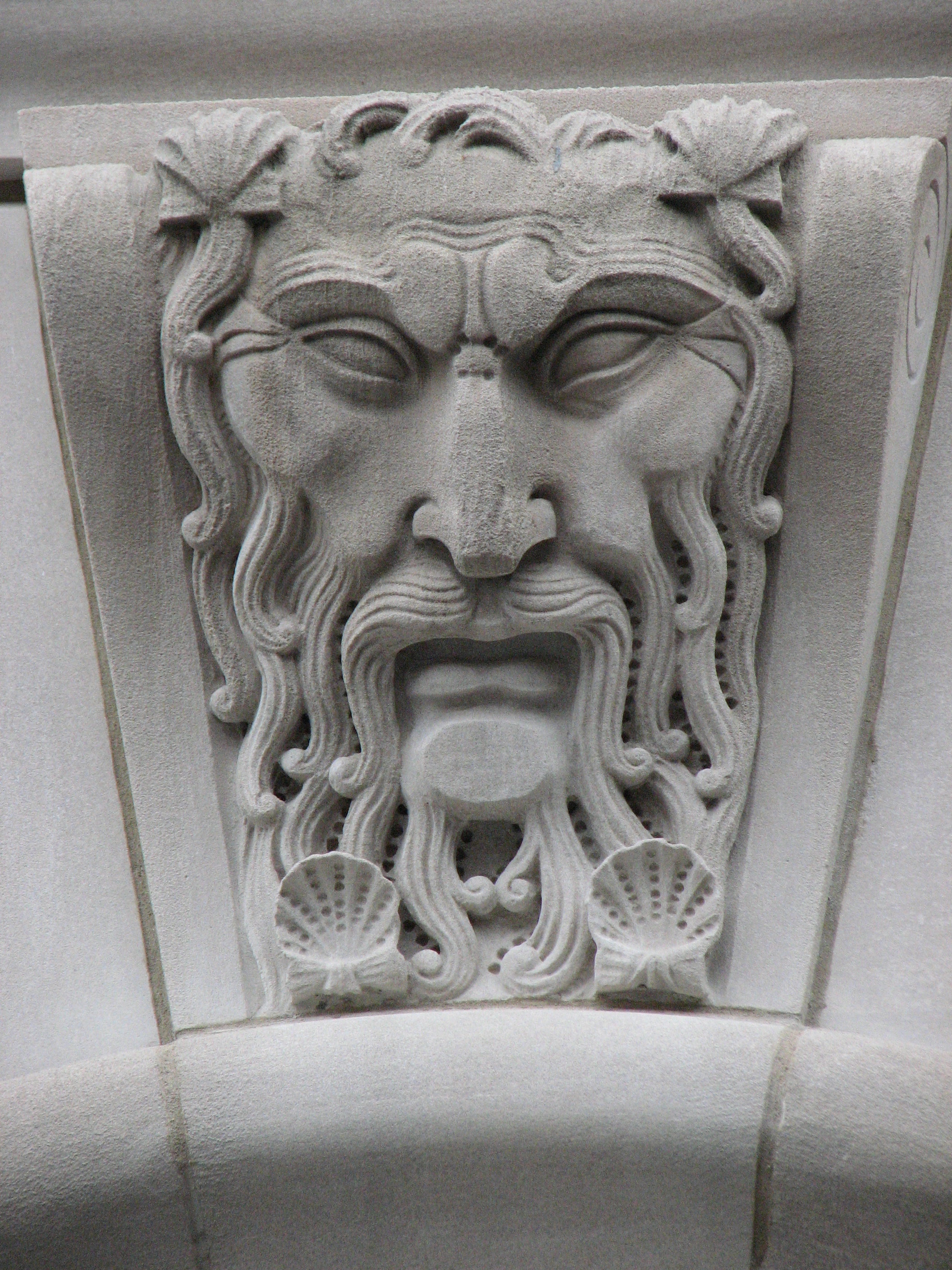 Neptune watches over comings and goings at the Custom House.