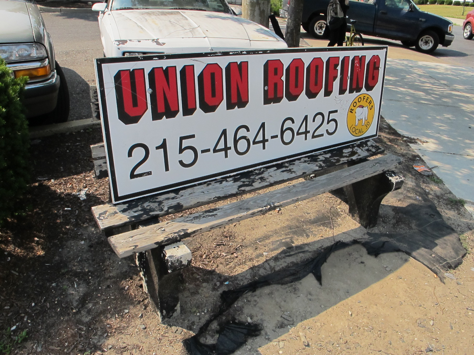 Decrepit Union Roofing bench on Aramingo Ave, June 2012. (removed)
