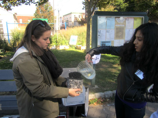 Before the scavenger hunt, Madeline Bell and Aisha Malika from the Fairmount Water Works Interpretive Center demonstrated how water can flow through porous pavement