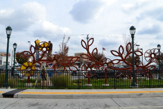 The sculpture, shown in progress here, stands at the entrance of the Cheltenham and Ogontz Bus Loop