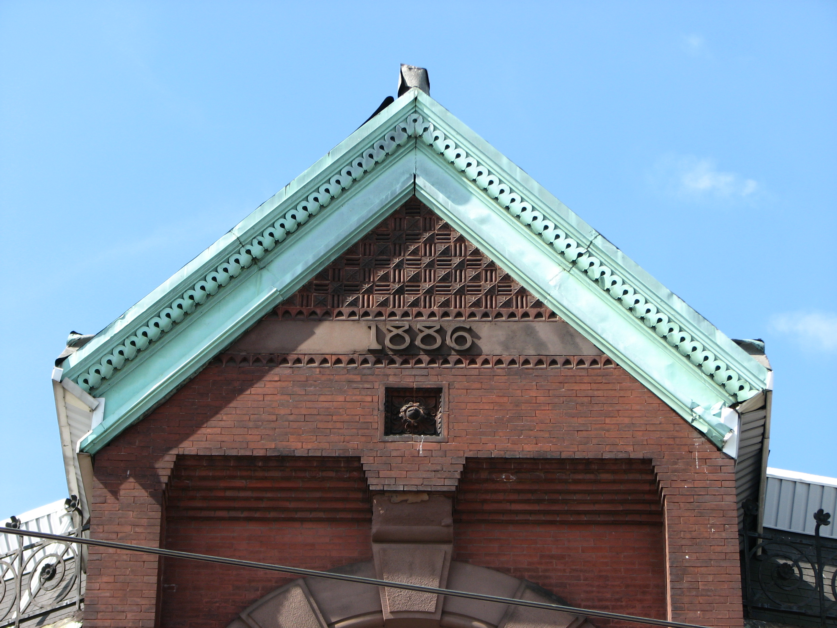 The gable at the top of the building announces the year of its birth.