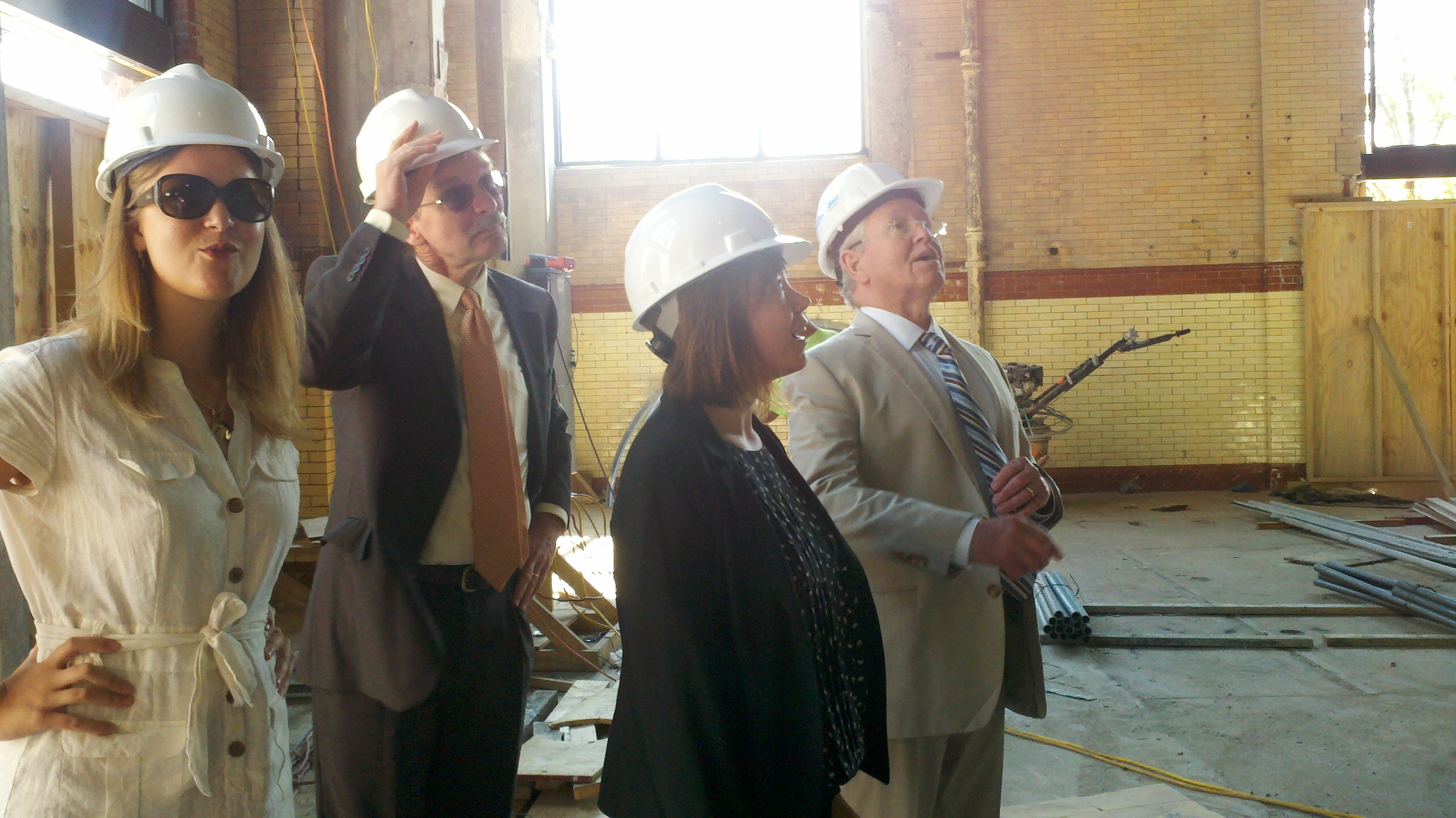 Philadelphia City Planning Commission Executive Director Gary Jastrzab - the man in back with his hand on his hard hat - joins DRWC Planners Lizzie Woods (next to Jastrzab) and Karen Thompson and DRWC President Tom Corcoran on a tour of the FringeArts building.