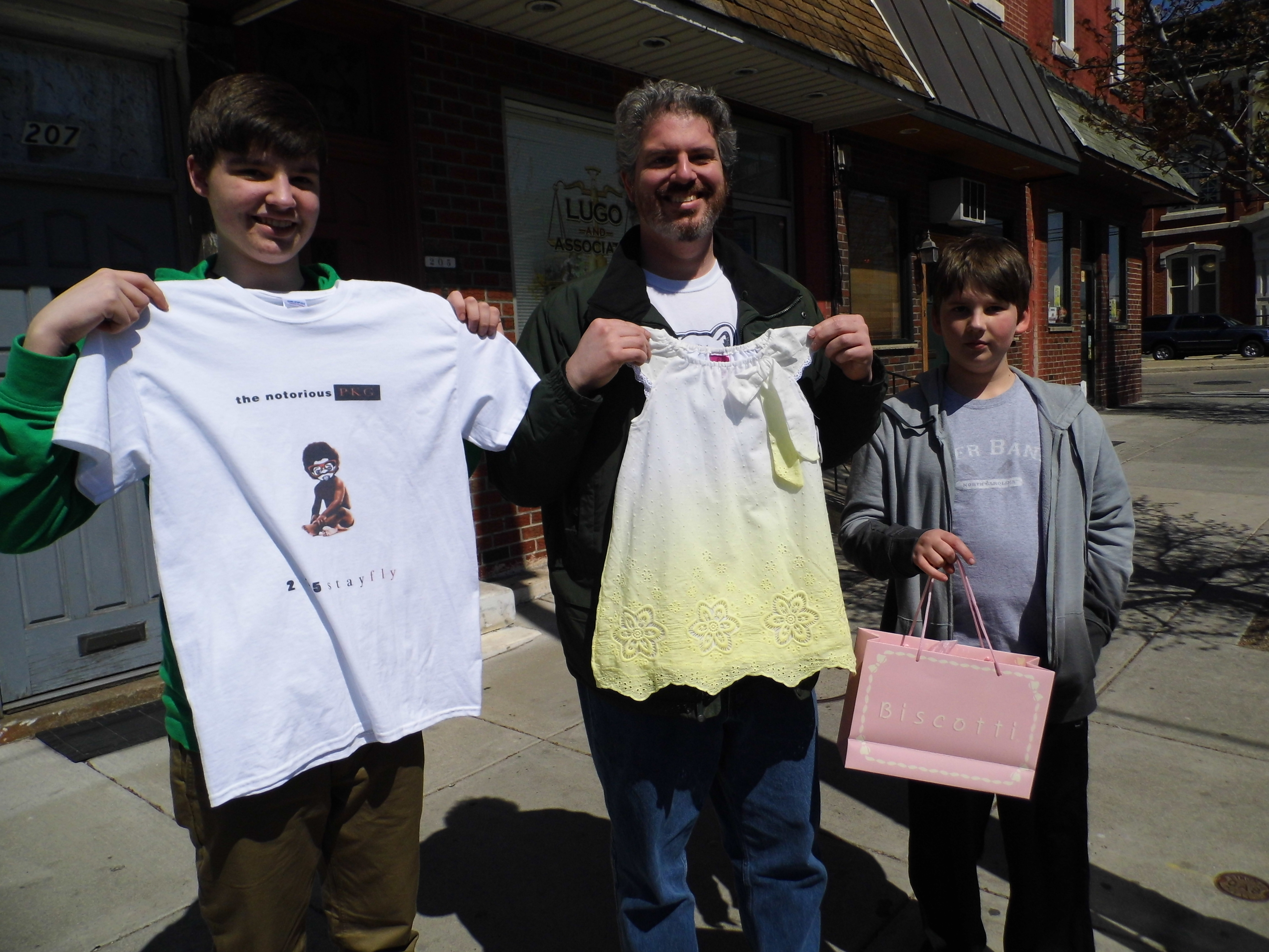 Resident Dan Abrams and sons Ben, 15, and Nathaniel,11, spent their Equal Dollars at Philly Kid Grafix, Kiddie Kouture and George's Pizza
