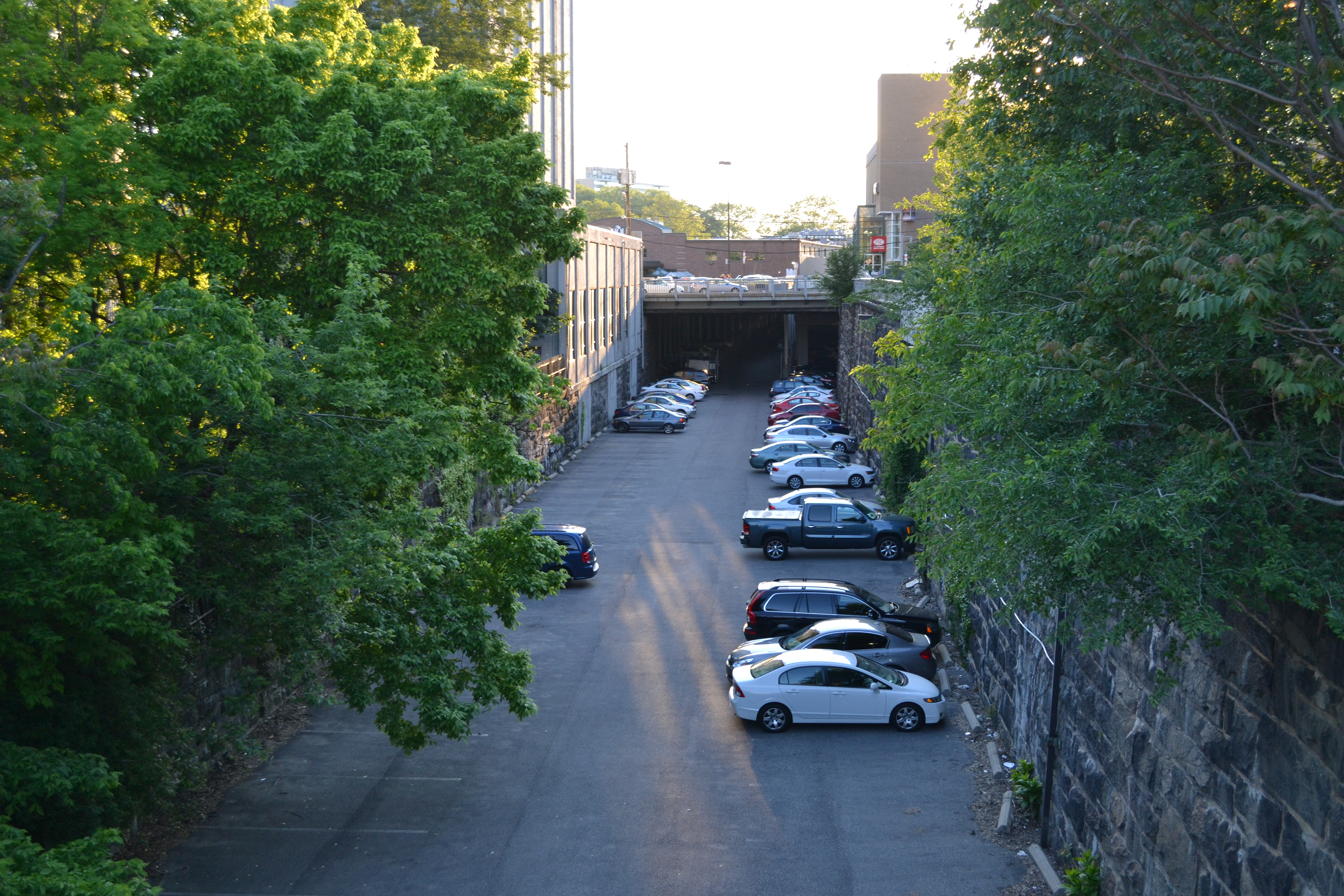 The former City Branch rail cut runs from Broad to 27th Street and portions are used for parking