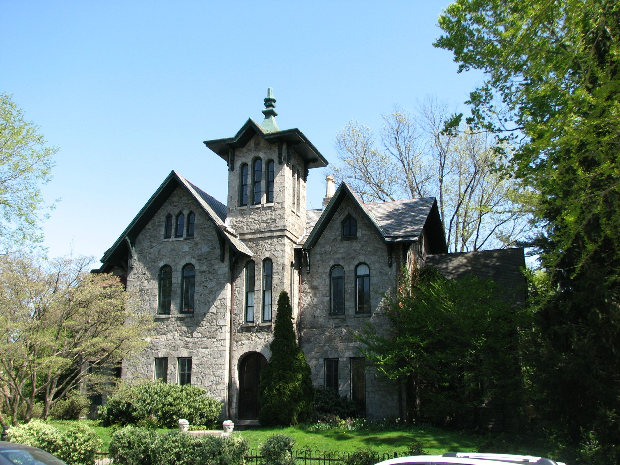 The severe Van Dyke Residence, 150 West Walnut, is also attributed to Samuel Sloan.