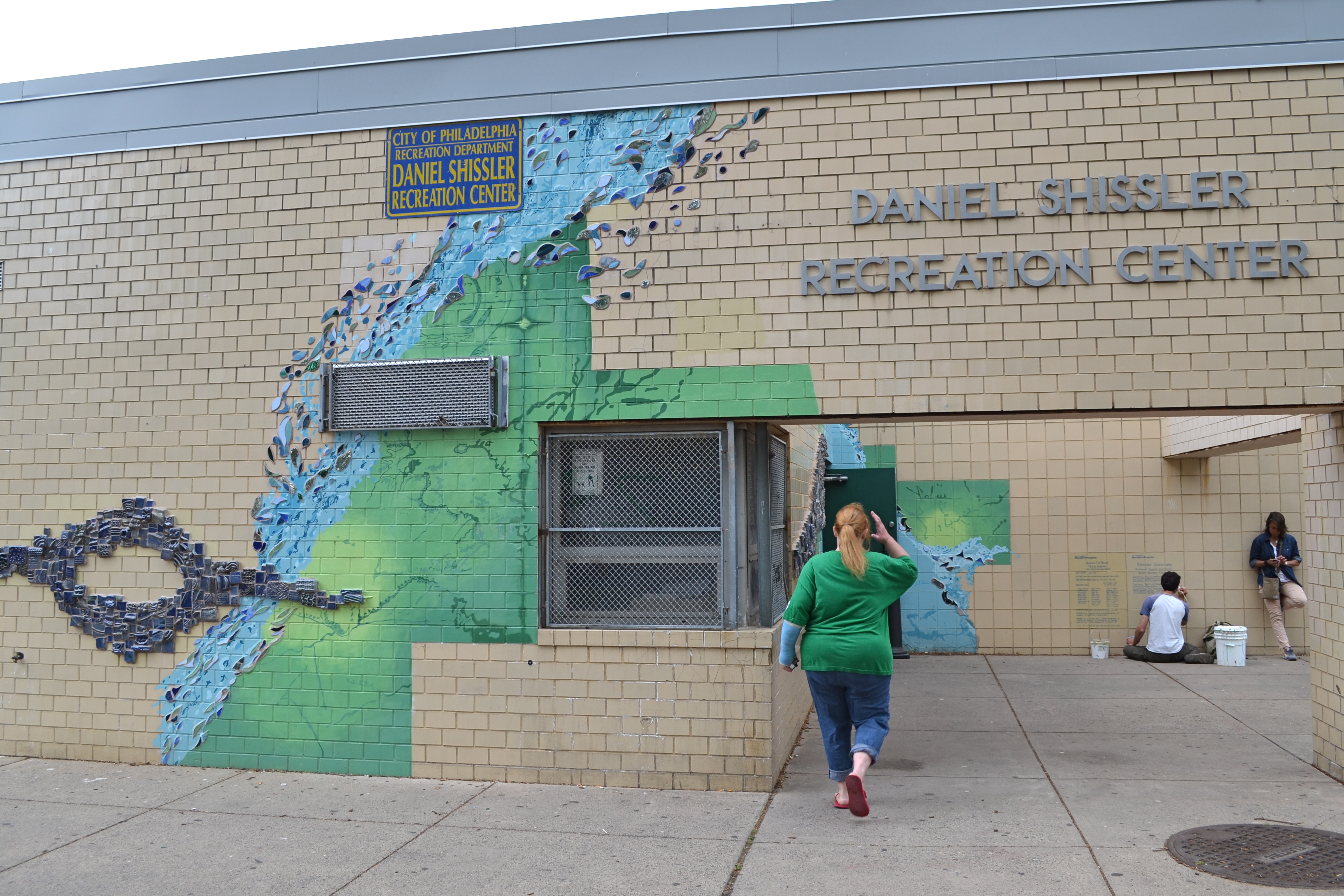 The sprayground is part of a Mural Arts Program initiative to enhance Shissler Rec Center