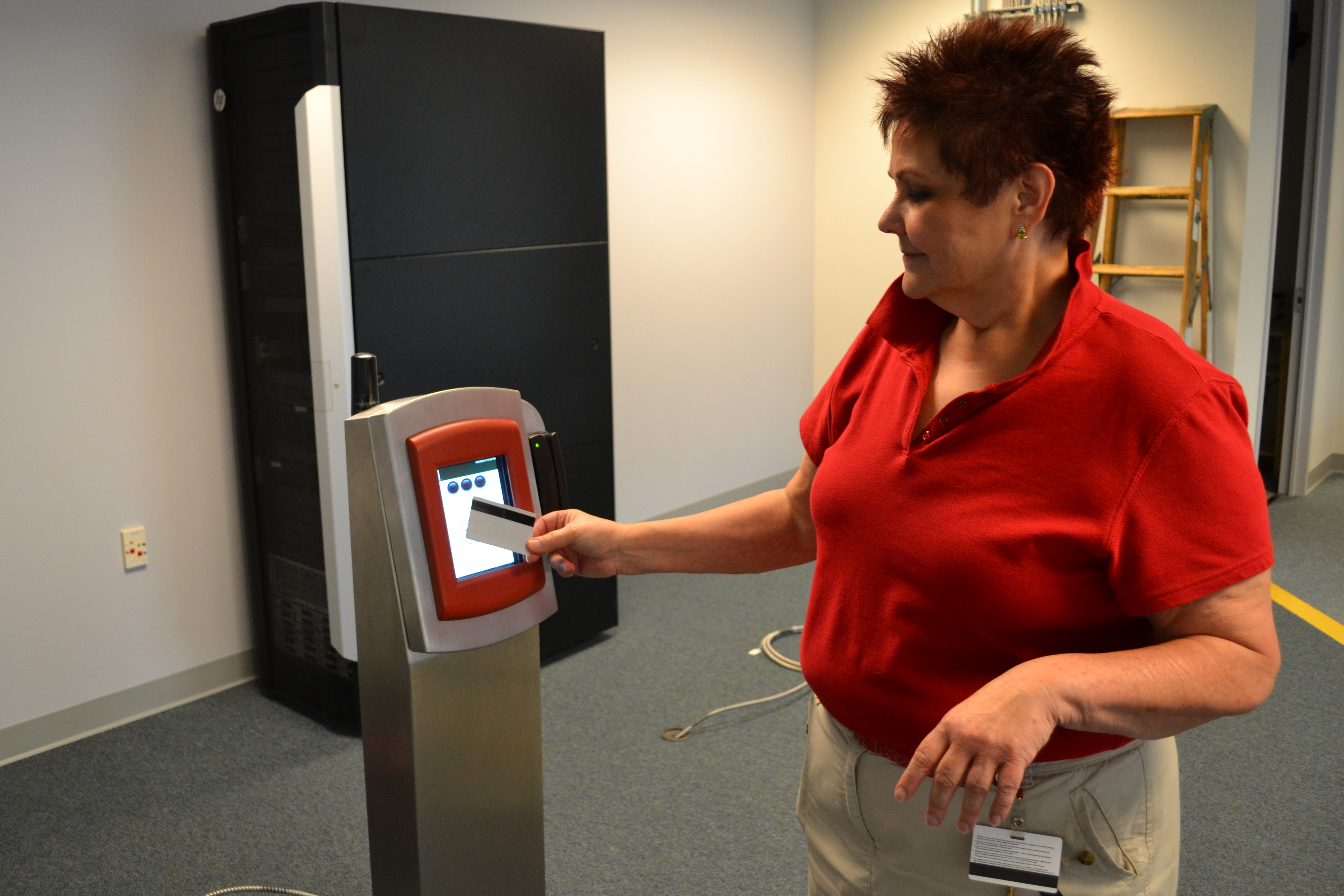 Leslie Hickman, deputy chief officer of NPT Integration, demonstrated how passengers will tap card readers at the outlying regional rail stations