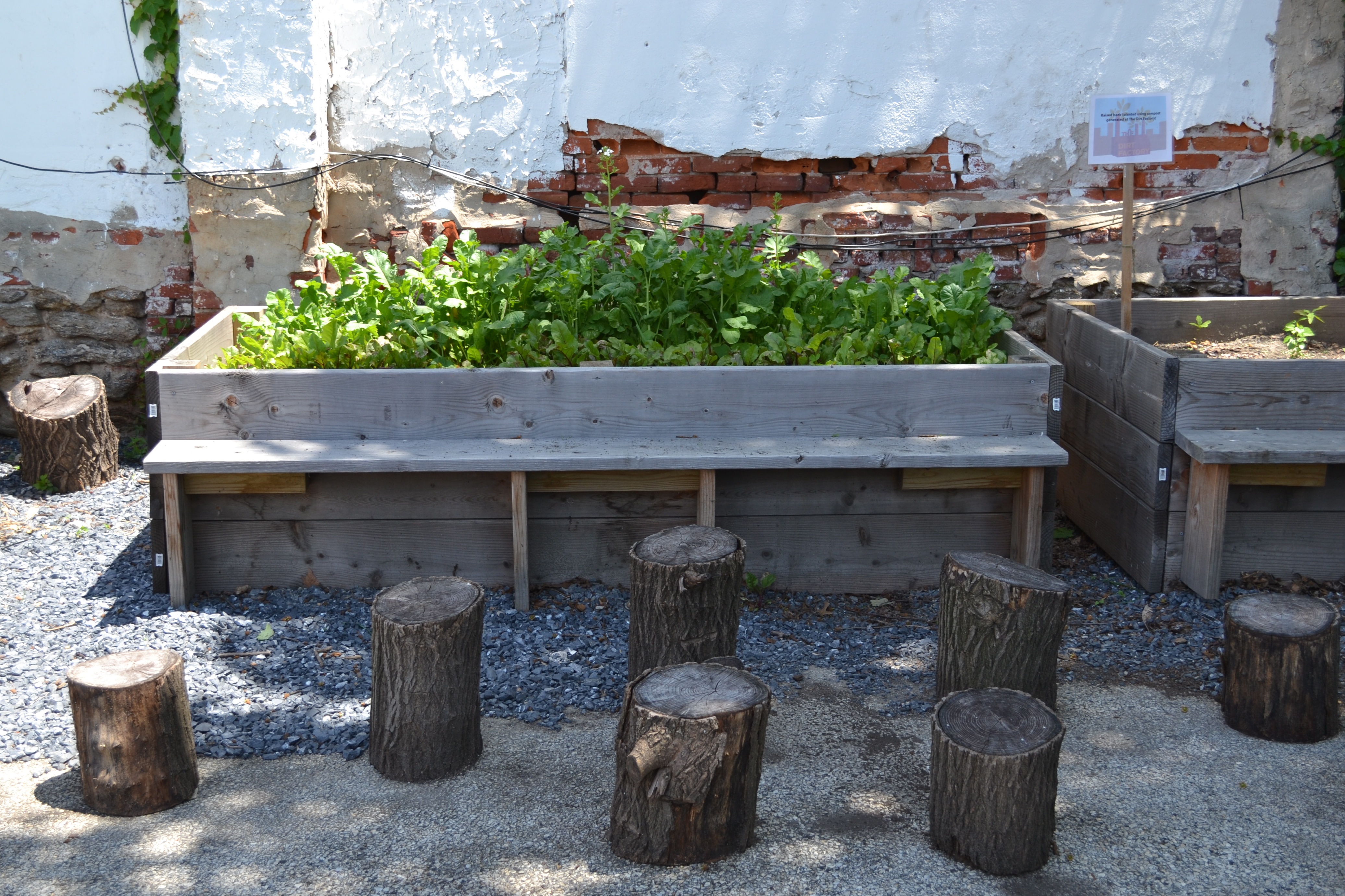 With recycled stump seating and vegetable beds, The Dirt Factory also serves as a community space