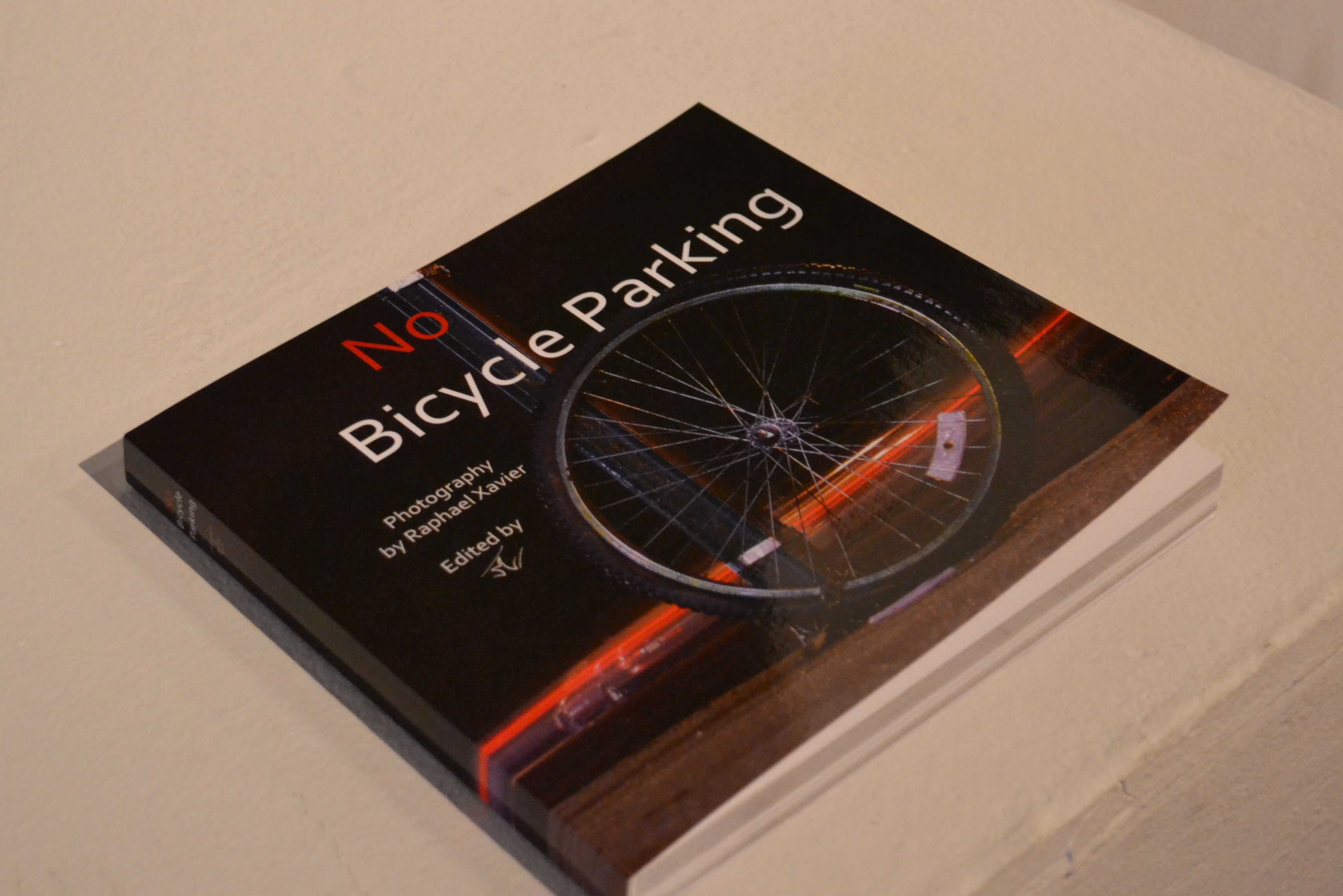 Xavier has printed a sample No Bicycle Parking book, but he plans to add more photos and personal stories