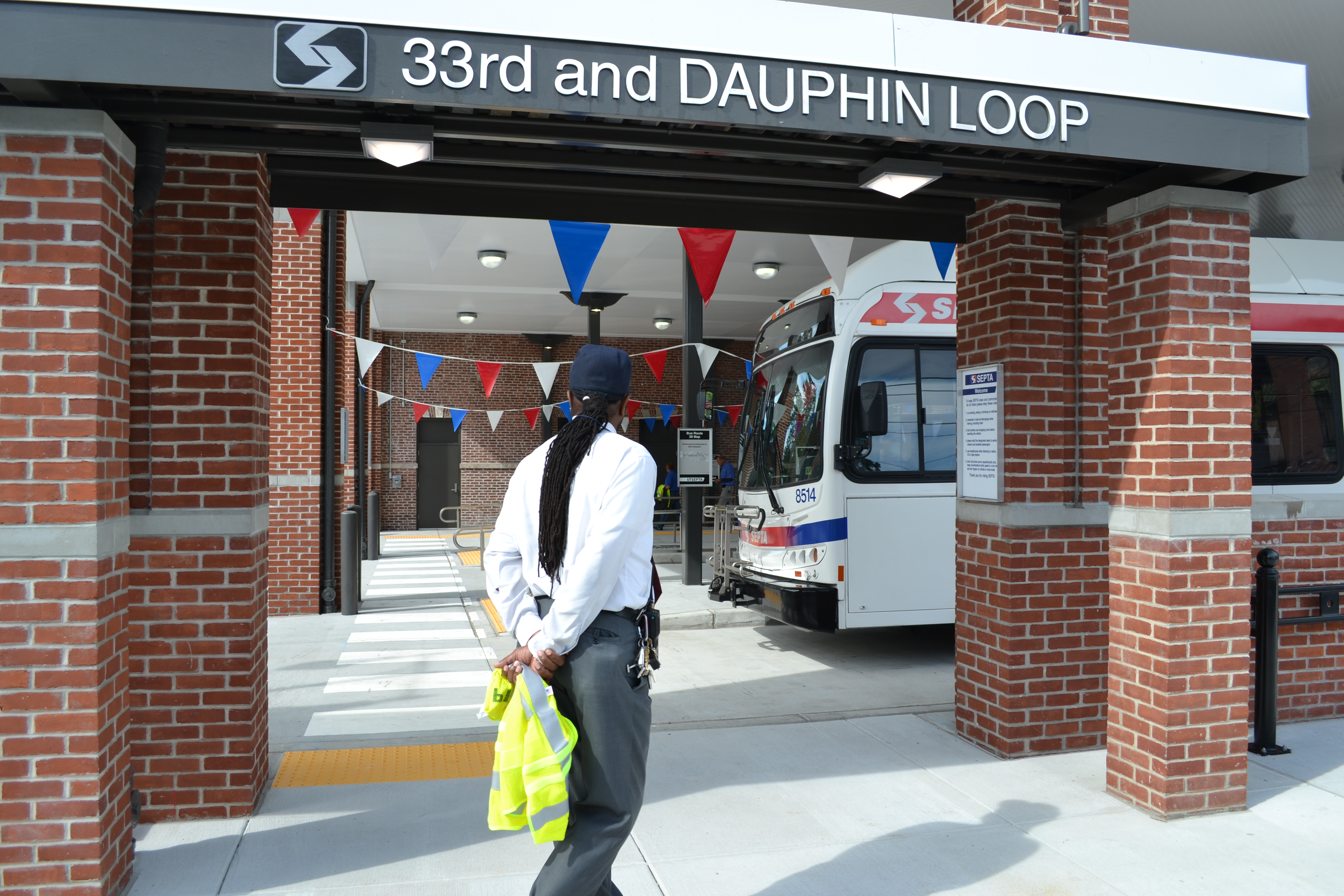 A SEPTA employee stood in a gateway into the bus loop