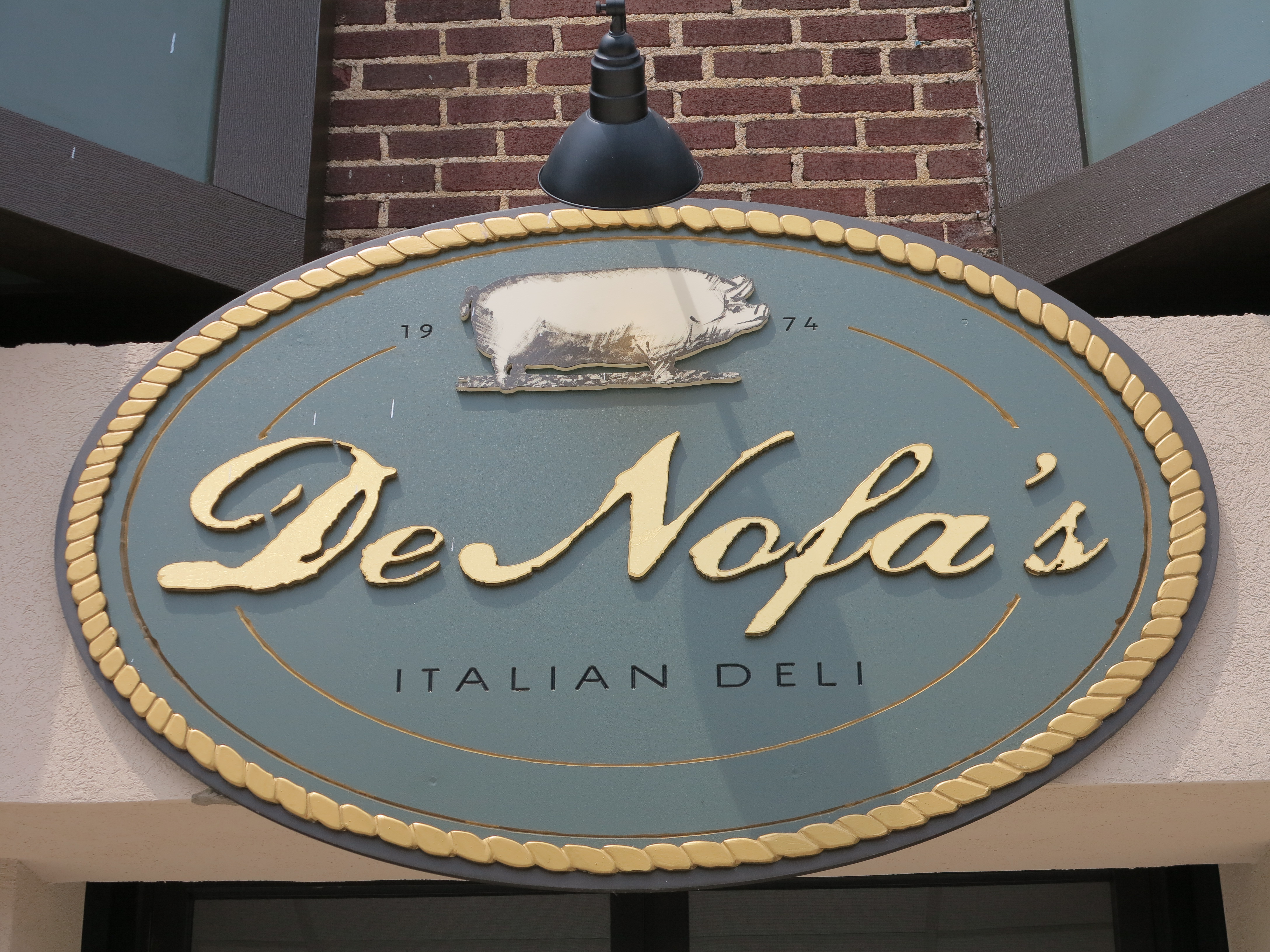 DeNofa's logo graces a new sign above the door