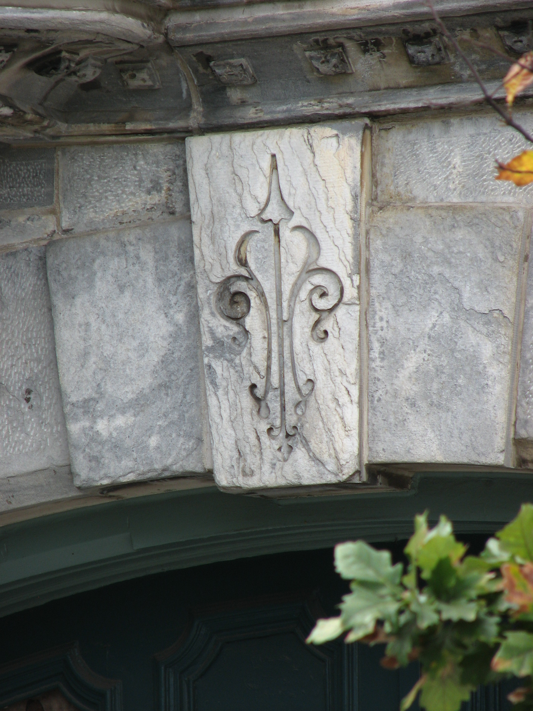 Fleur-de-lys are etched in the keystones of the former firehouse.