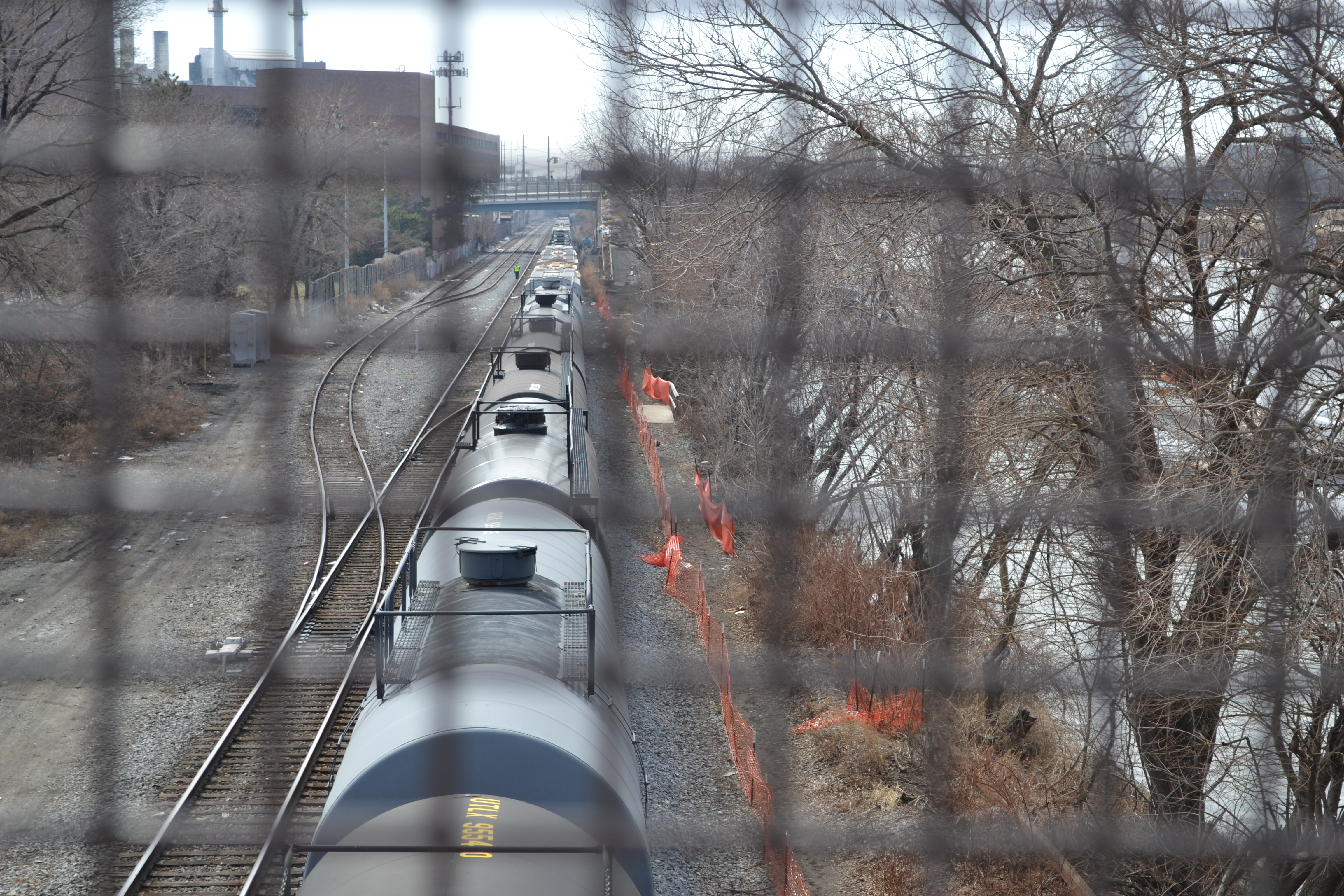 Freight cars stretch back as far as the eye can see on tracks along the Schuylkill River