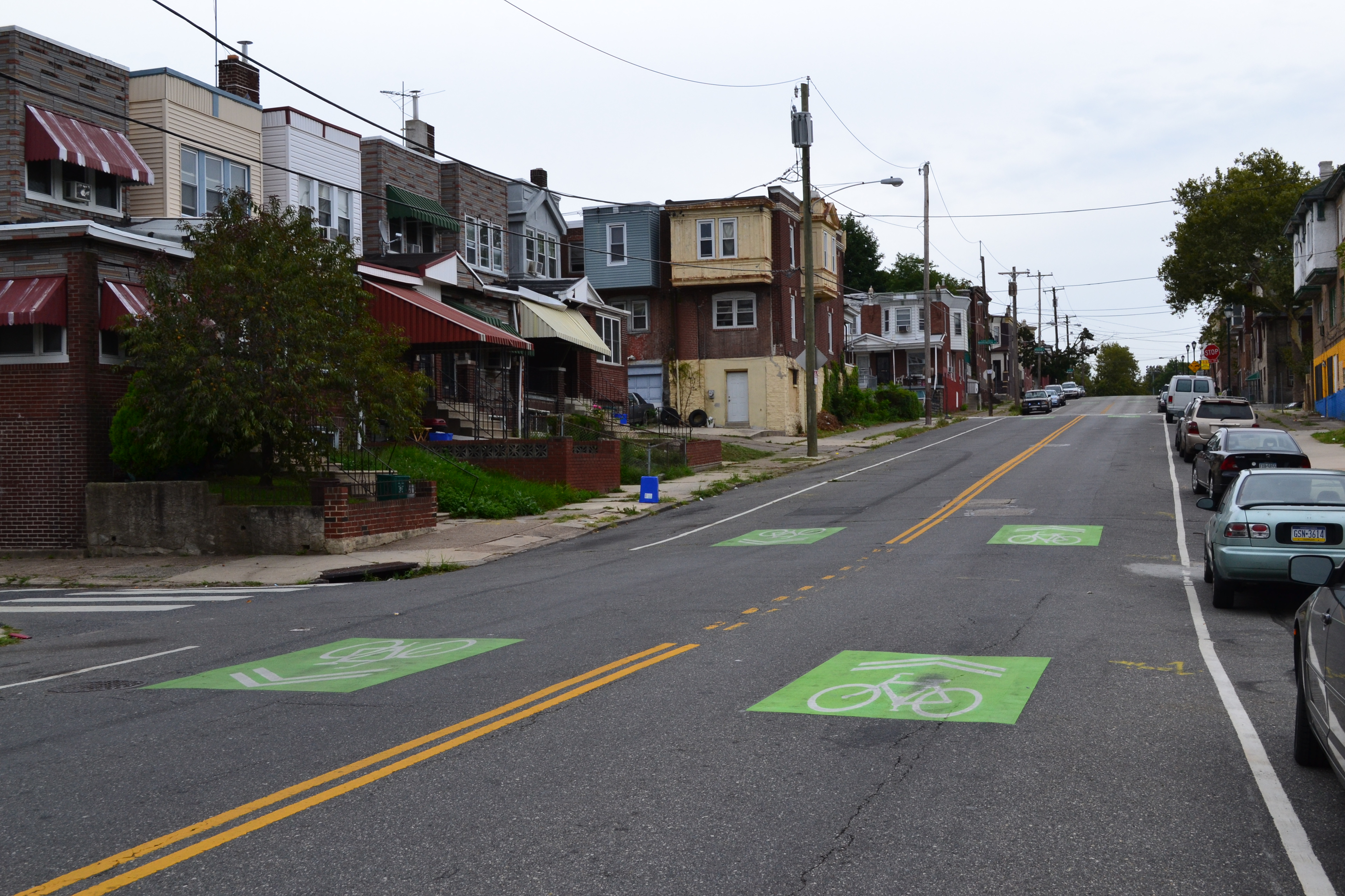 Green sharrows lead cyclists from the Cobbs Creek Trail to the 58th Street Greenway, a mostly off-road trail