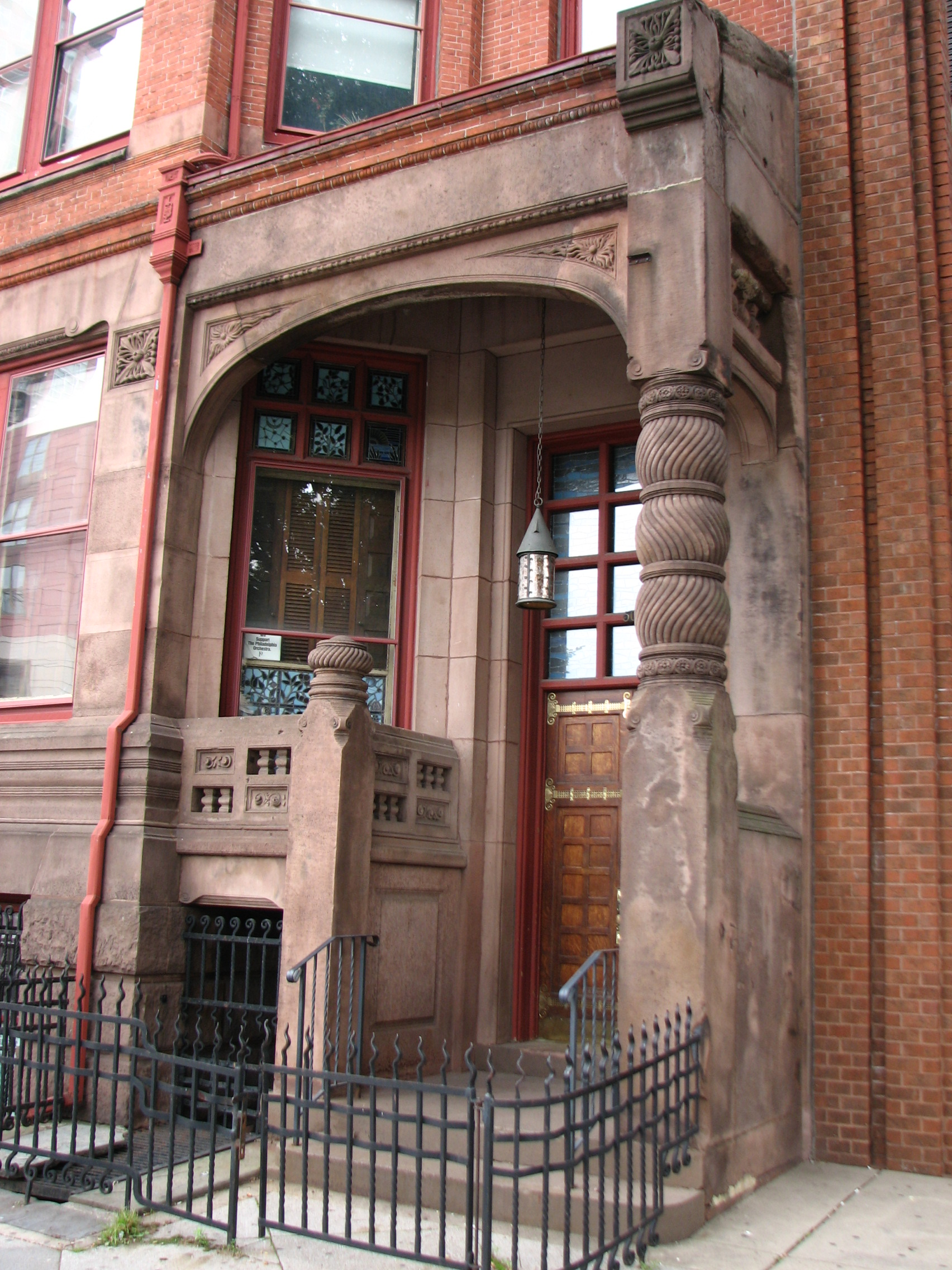 The entrance to the Lippincott House features elaborate ironwork and carved brownstone.