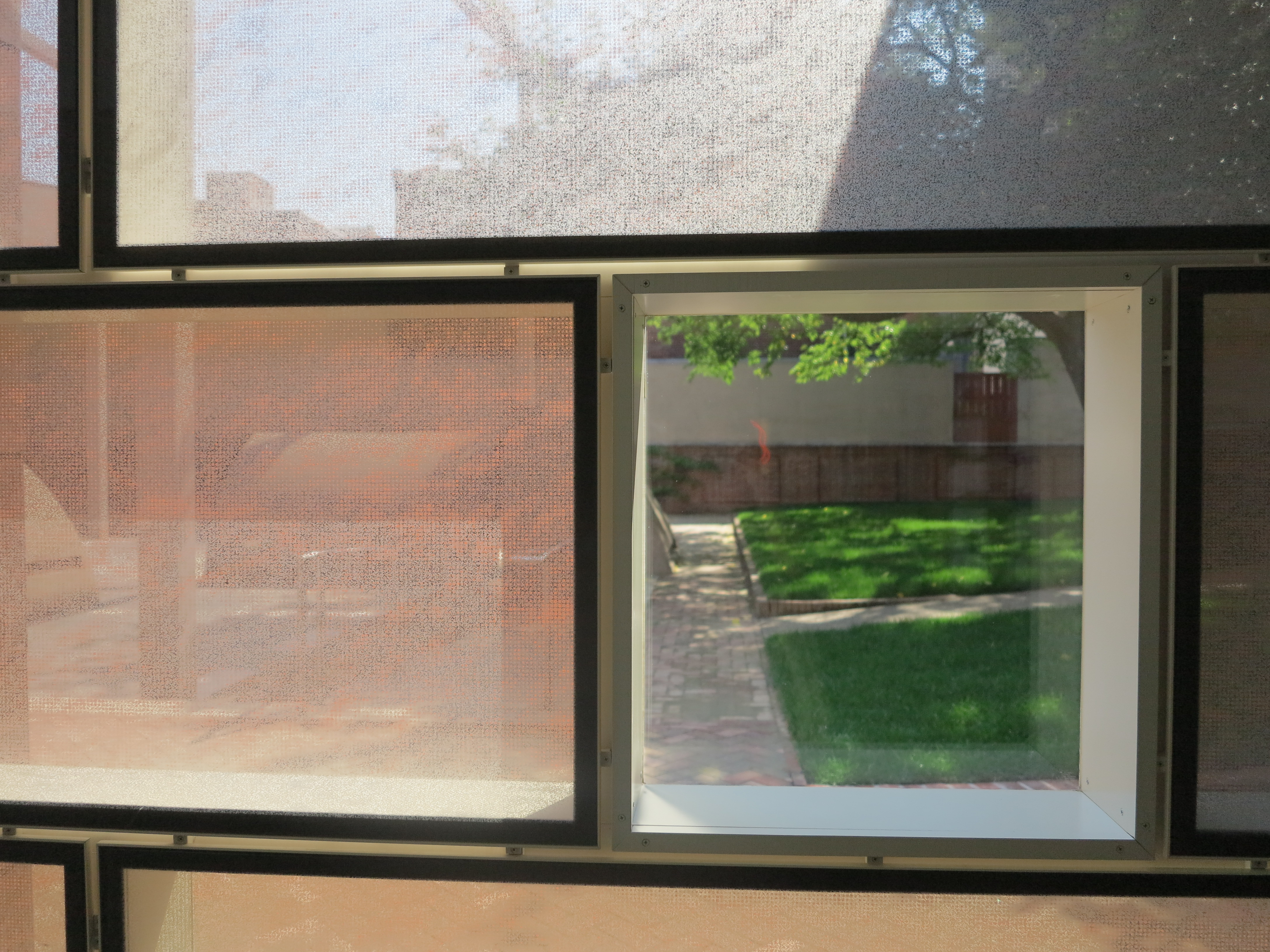 Looking through the fretted glass panels into Franklin Court.