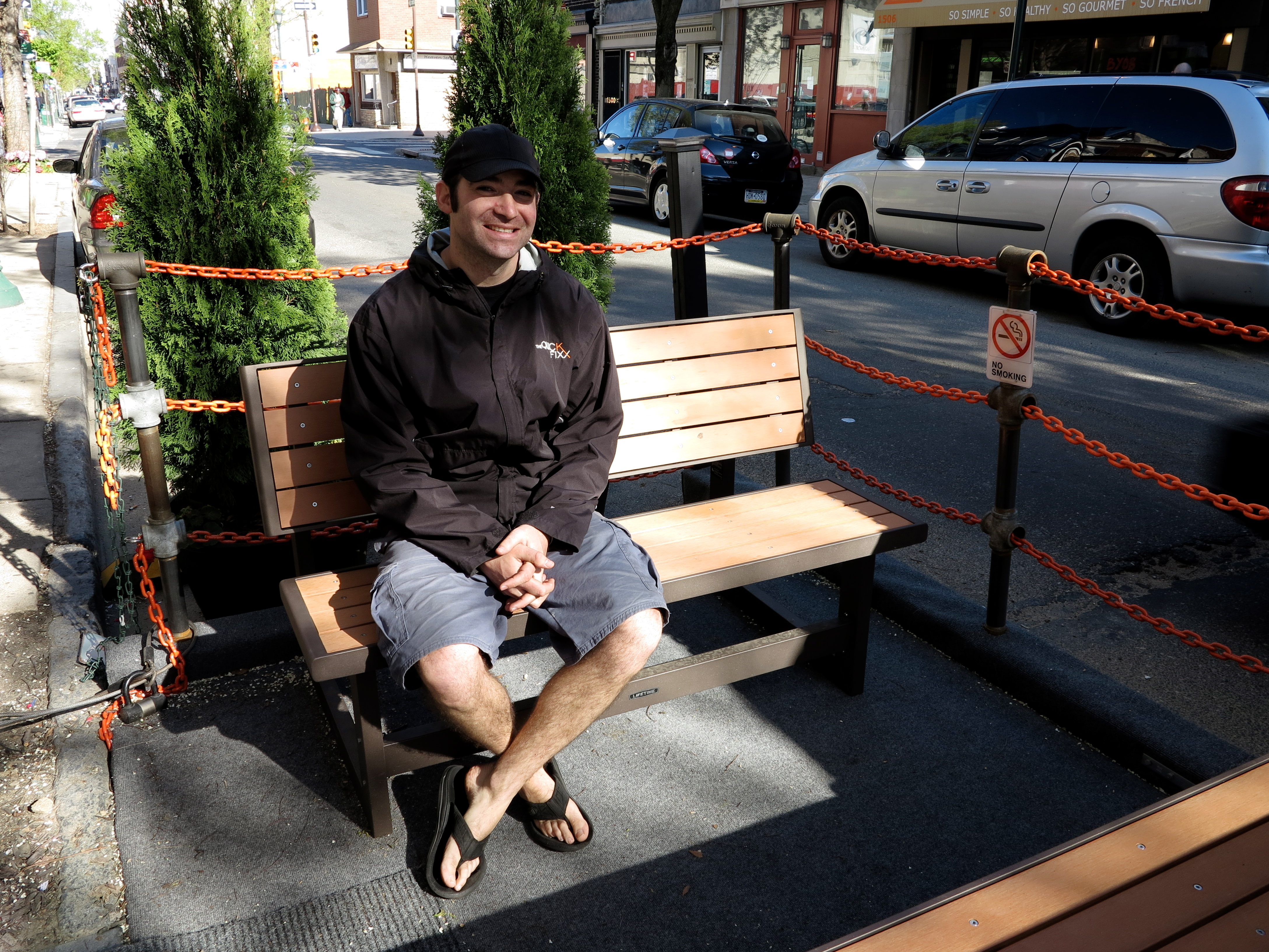 Matt Levinson, owner of The Quick Fixx giving the new parklet a test