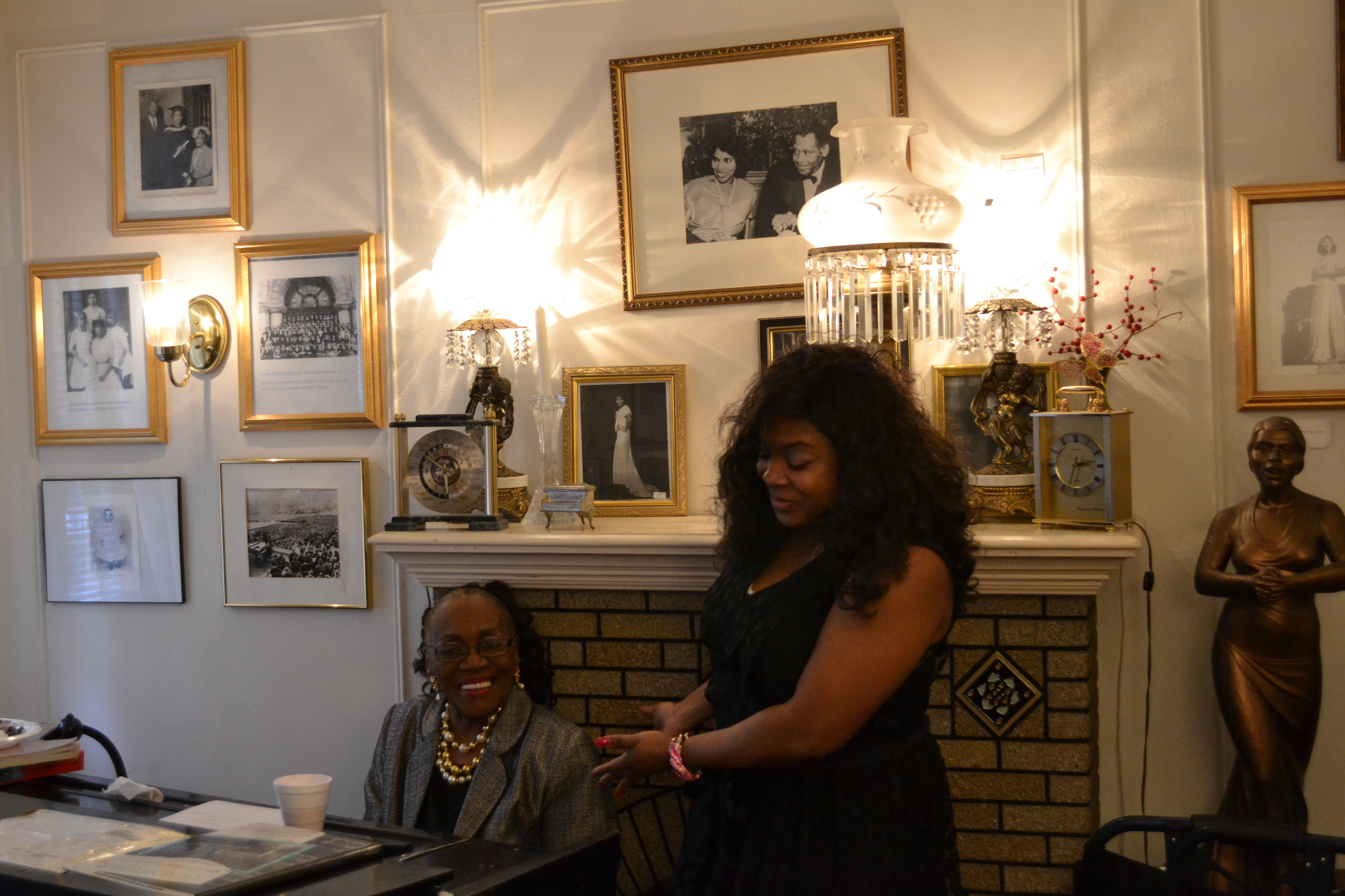 Lady Blancheburton Lyles, left, and Jillian Patricia Pirtle, right, perform some of Anderson's music