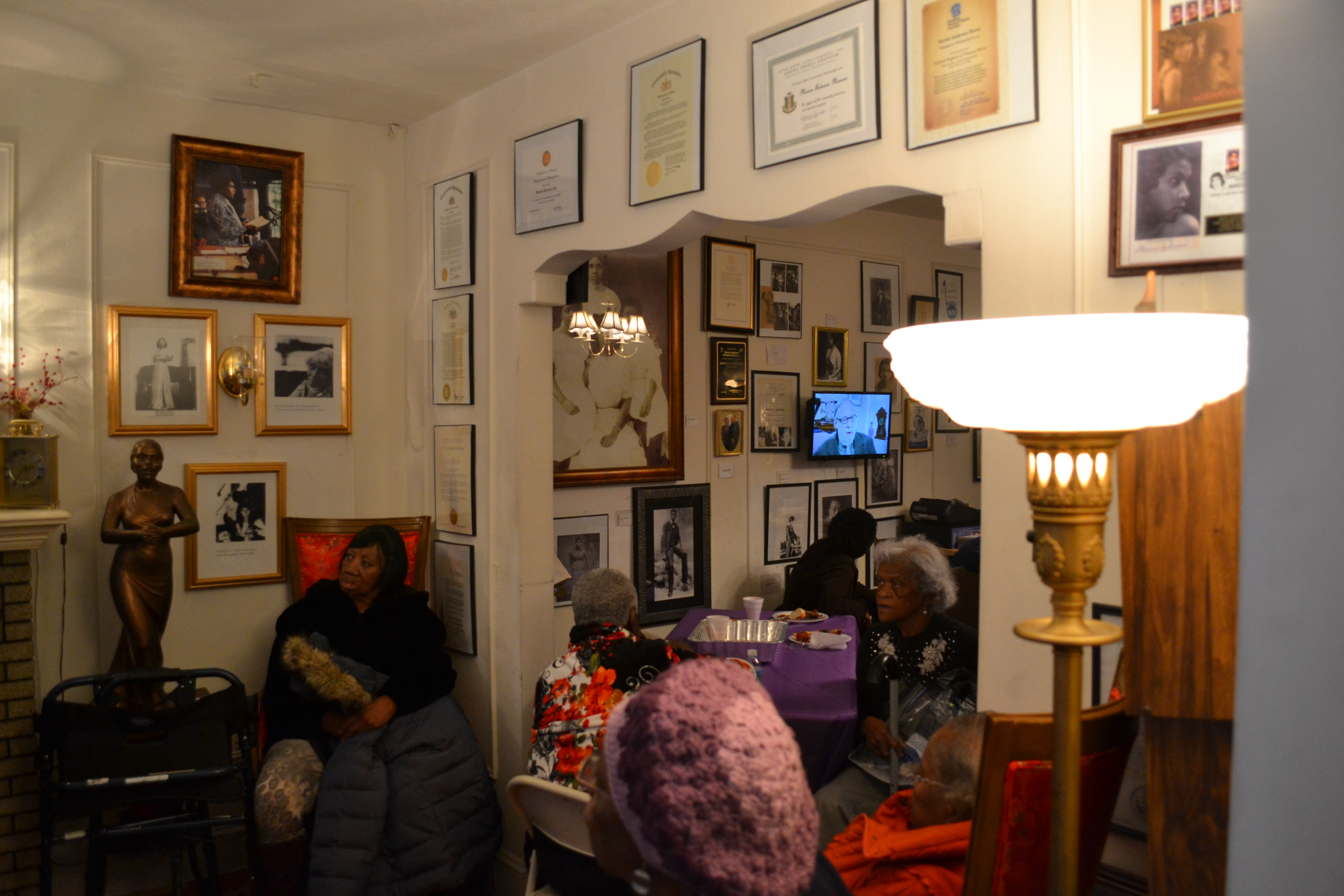 Photos, plaques and certificates line the wall of Anderson's home, now the Marian Anderson Residence Museum