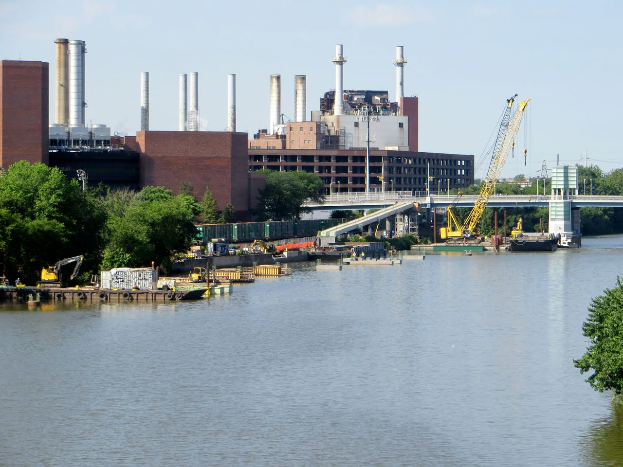 Phases of construction and equipment span the Schuylkill's banks